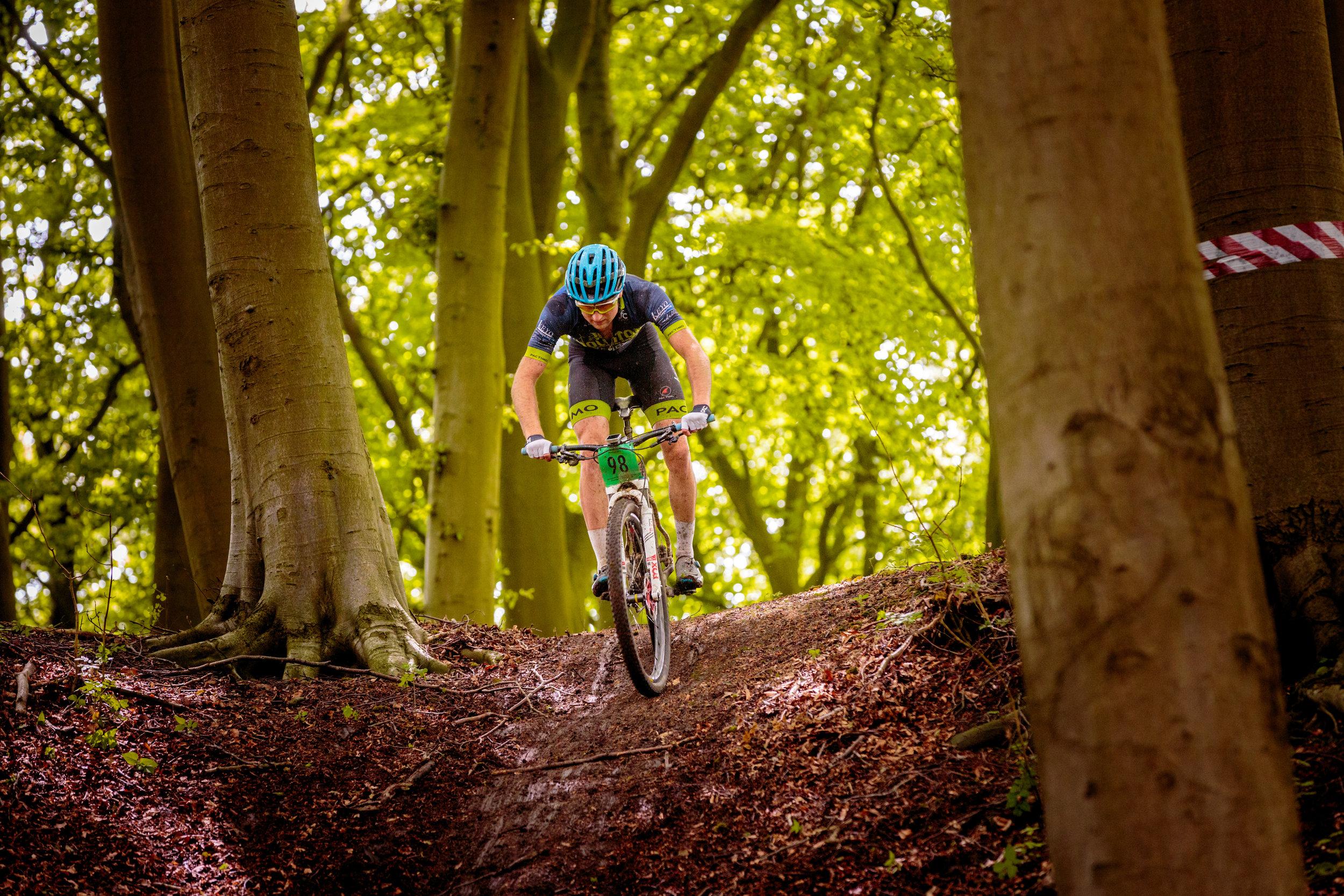 A mountain biker negotiating a steep decent