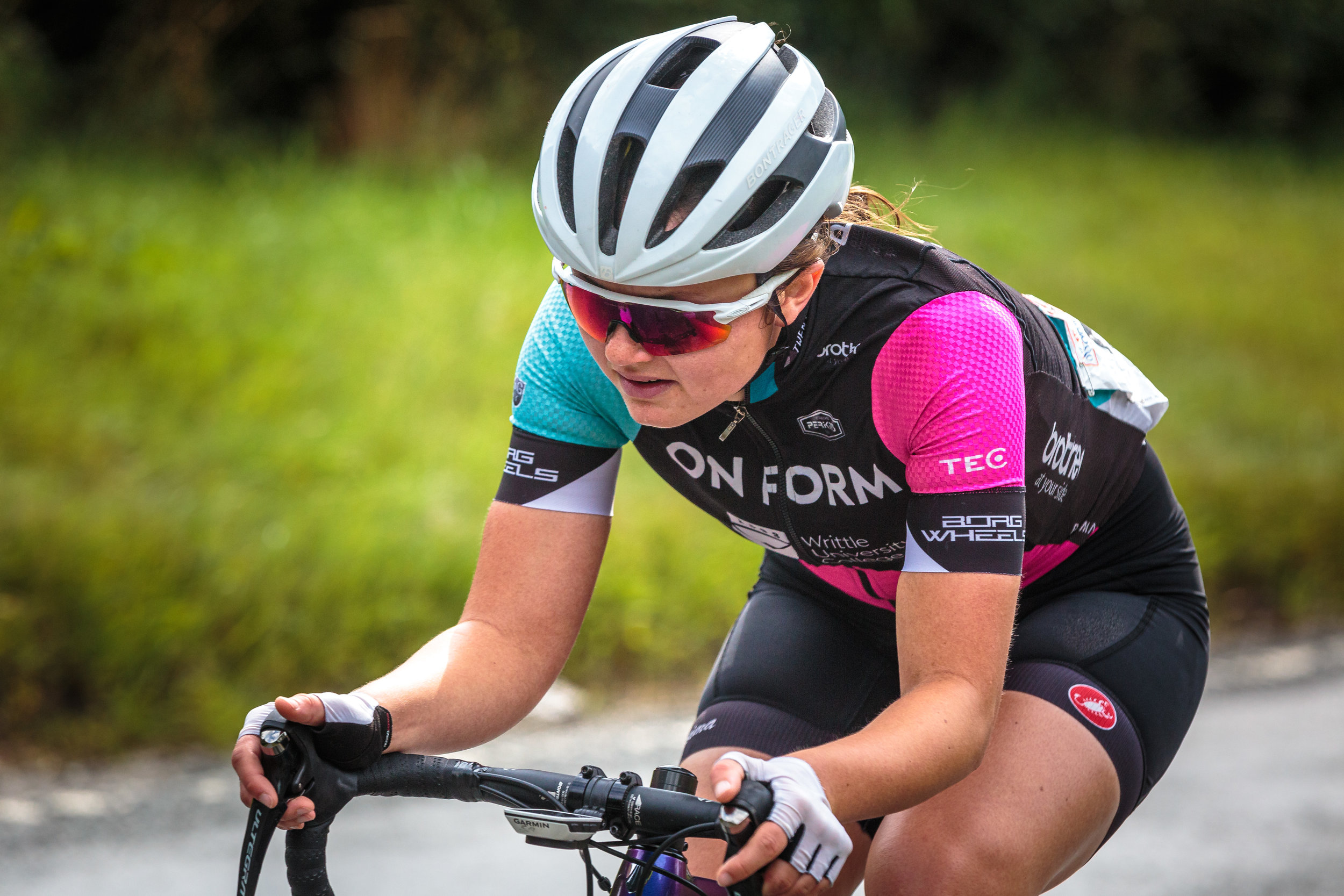 Close up of a female cyclist for team On Form