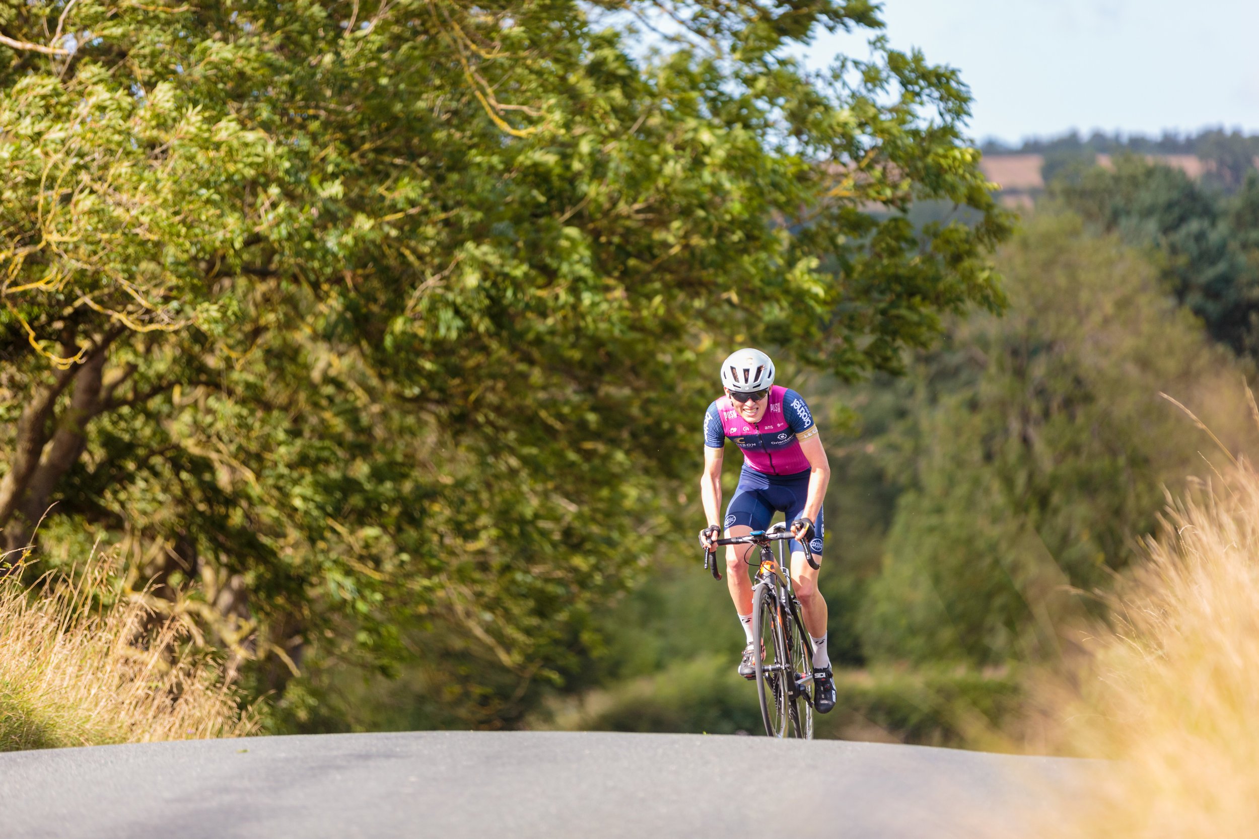 Crimson Performance Rider Crests a Climb