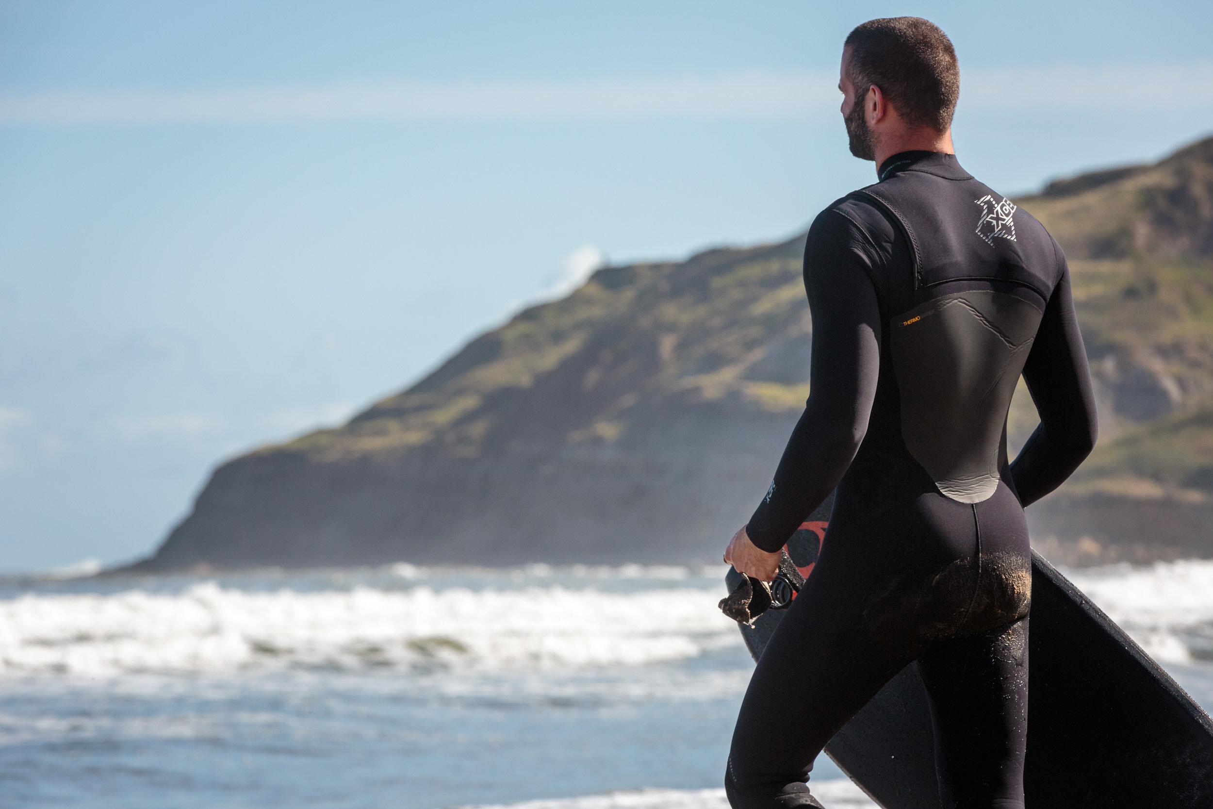 Bodyboarder Walking to Sea