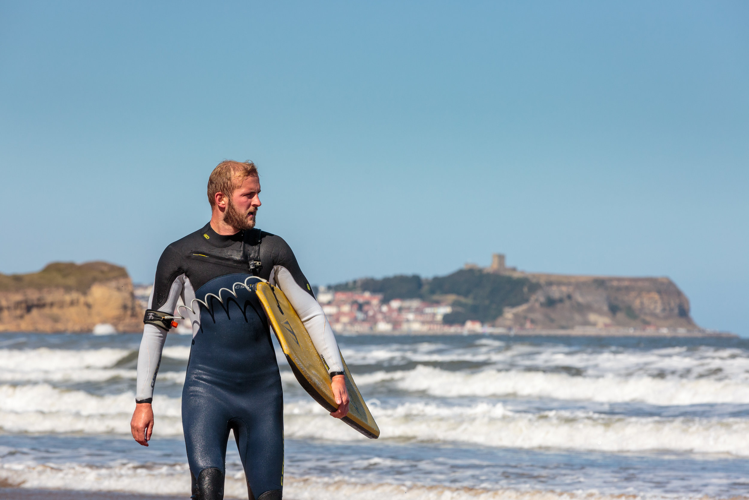 Bodyboarder in front of Scarborough Castle