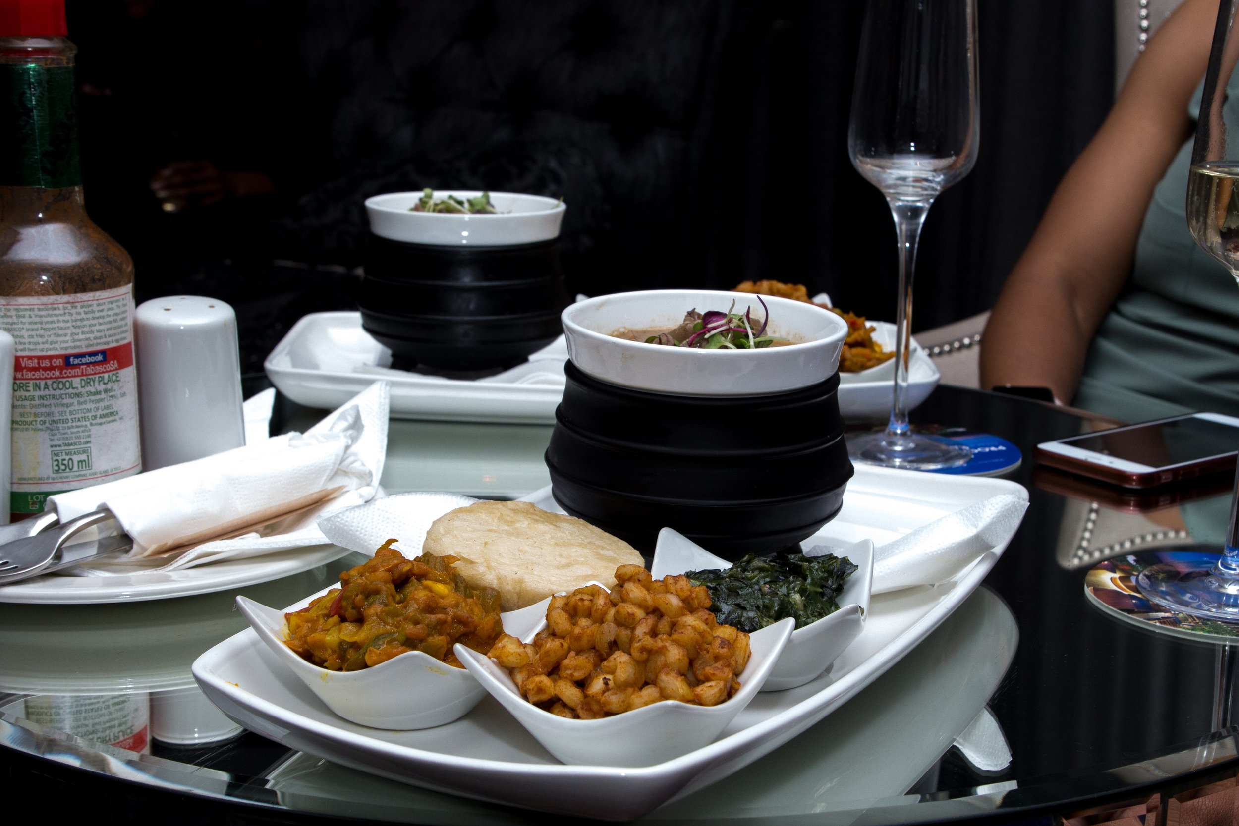 Traditional Potjie with traditional vegetable dishes.jpg