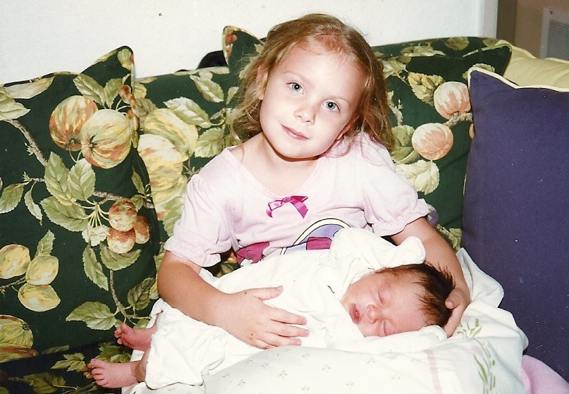 My baby brother, Hank, and I after he was born.