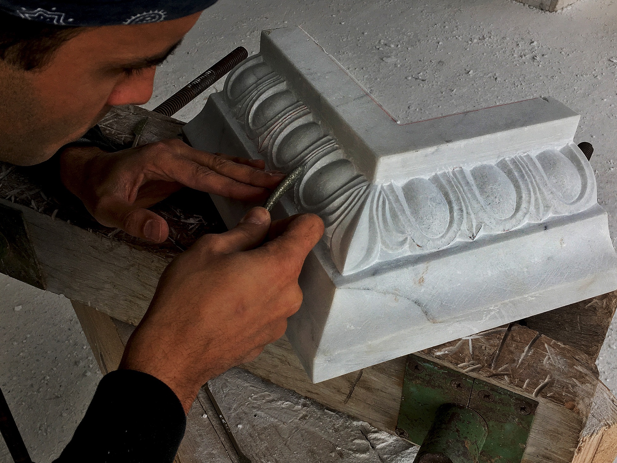 Stone-sculptor-carving-architectural-cornice.JPG