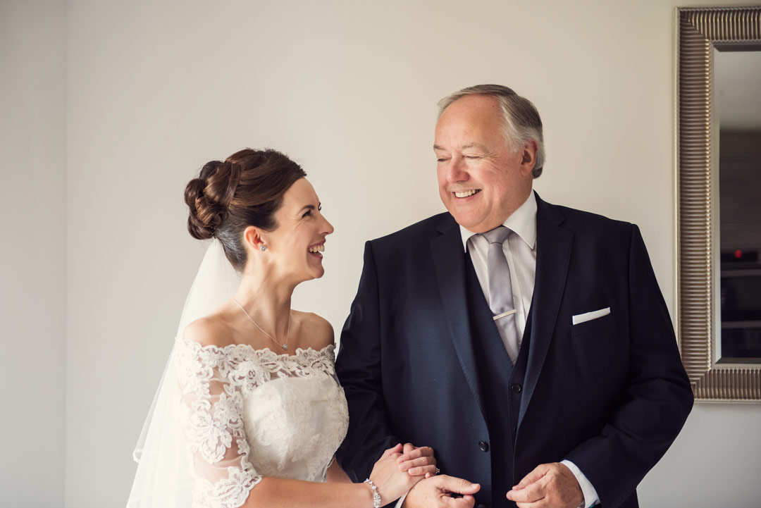 Father and Bride laughing together