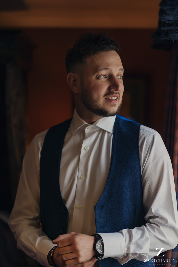 Classic Groom portrait in window light