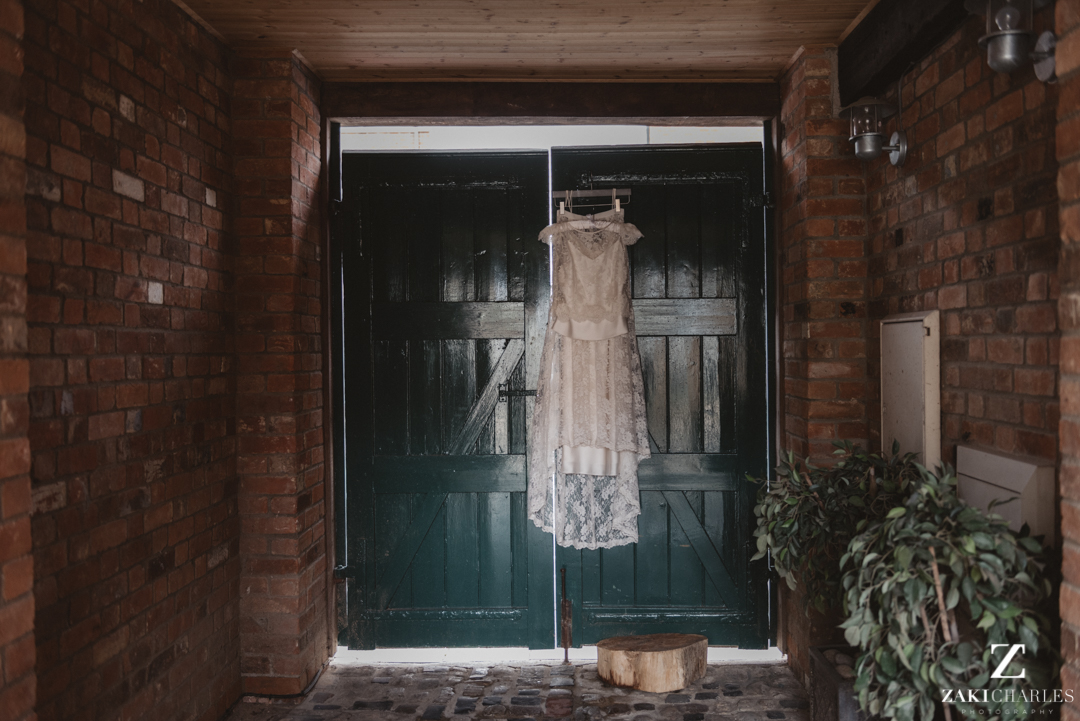 Wedding dress hanging in the sunlight