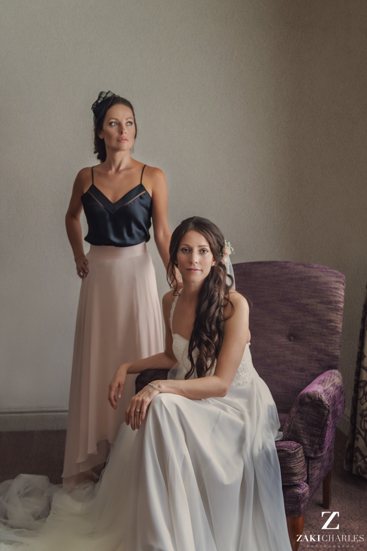 Bride sitting with her maid of honour