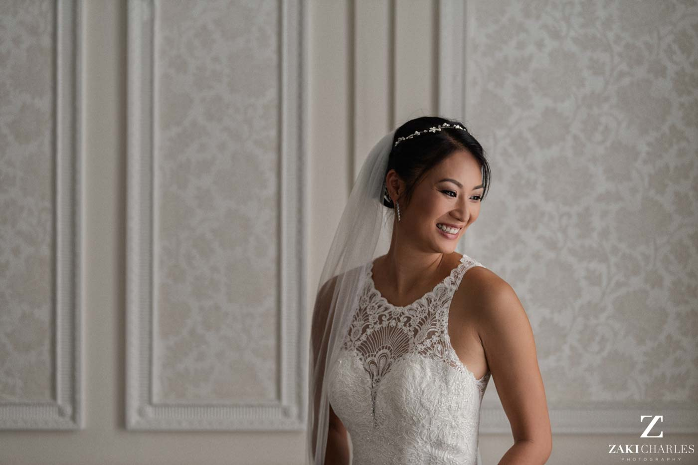 Natural light portrait of bride Candy laughing at Hedsor House
