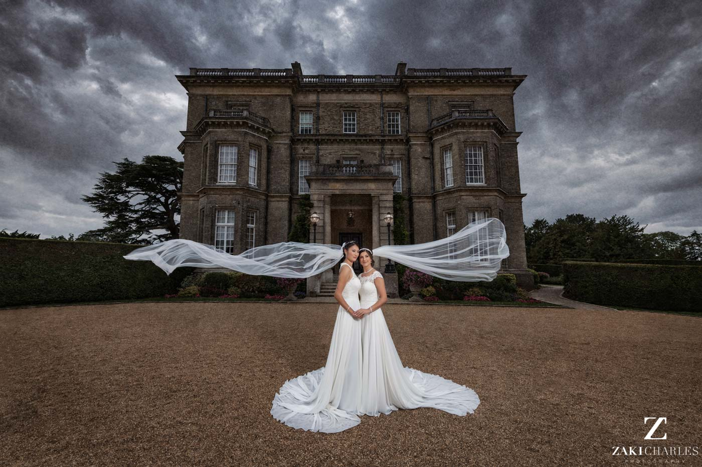 Brides veil flowing in the wind at Hedsor House