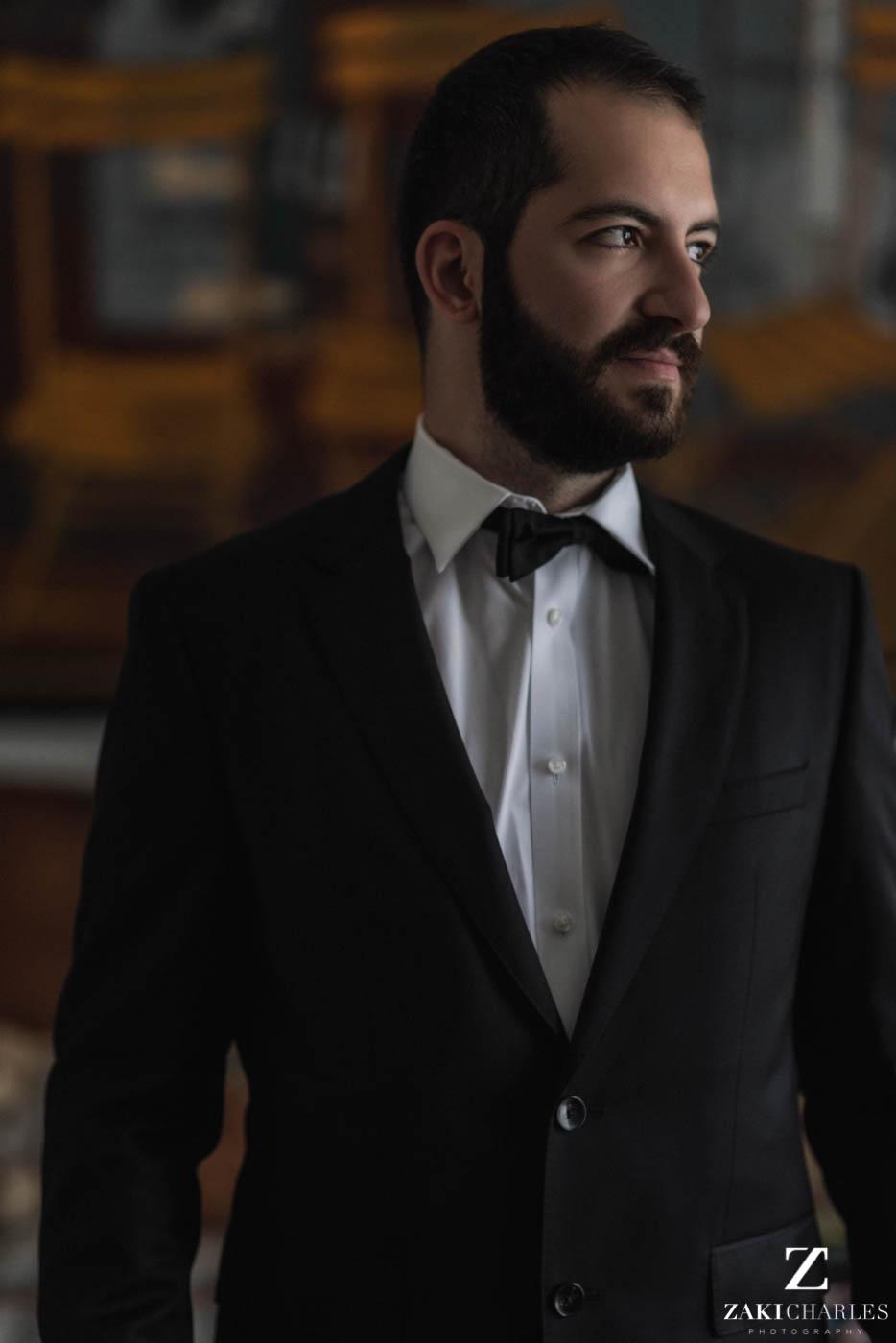 Natural light portrait of groom preperation at Marriott Hotel Regents Park 3