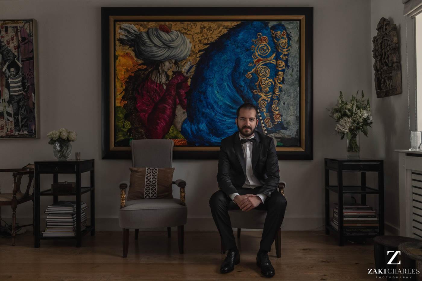 Natural light portrait of groom preperation at Marriott Hotel Regents Park 4