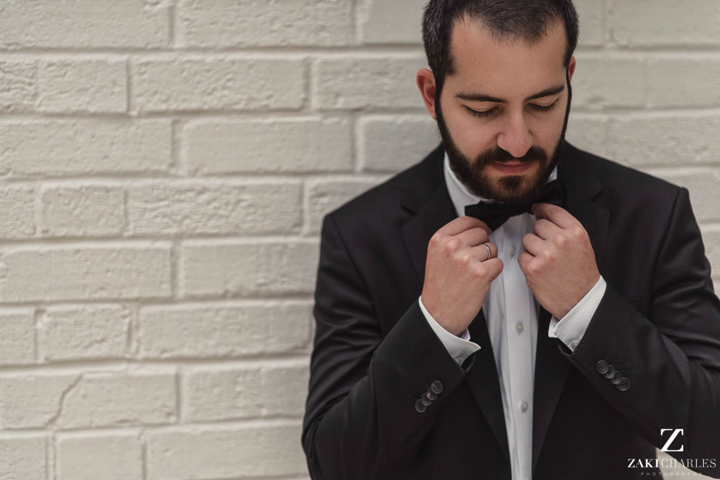 Natural light portrait of groom preperation at Marriott Hotel Regents Park 5