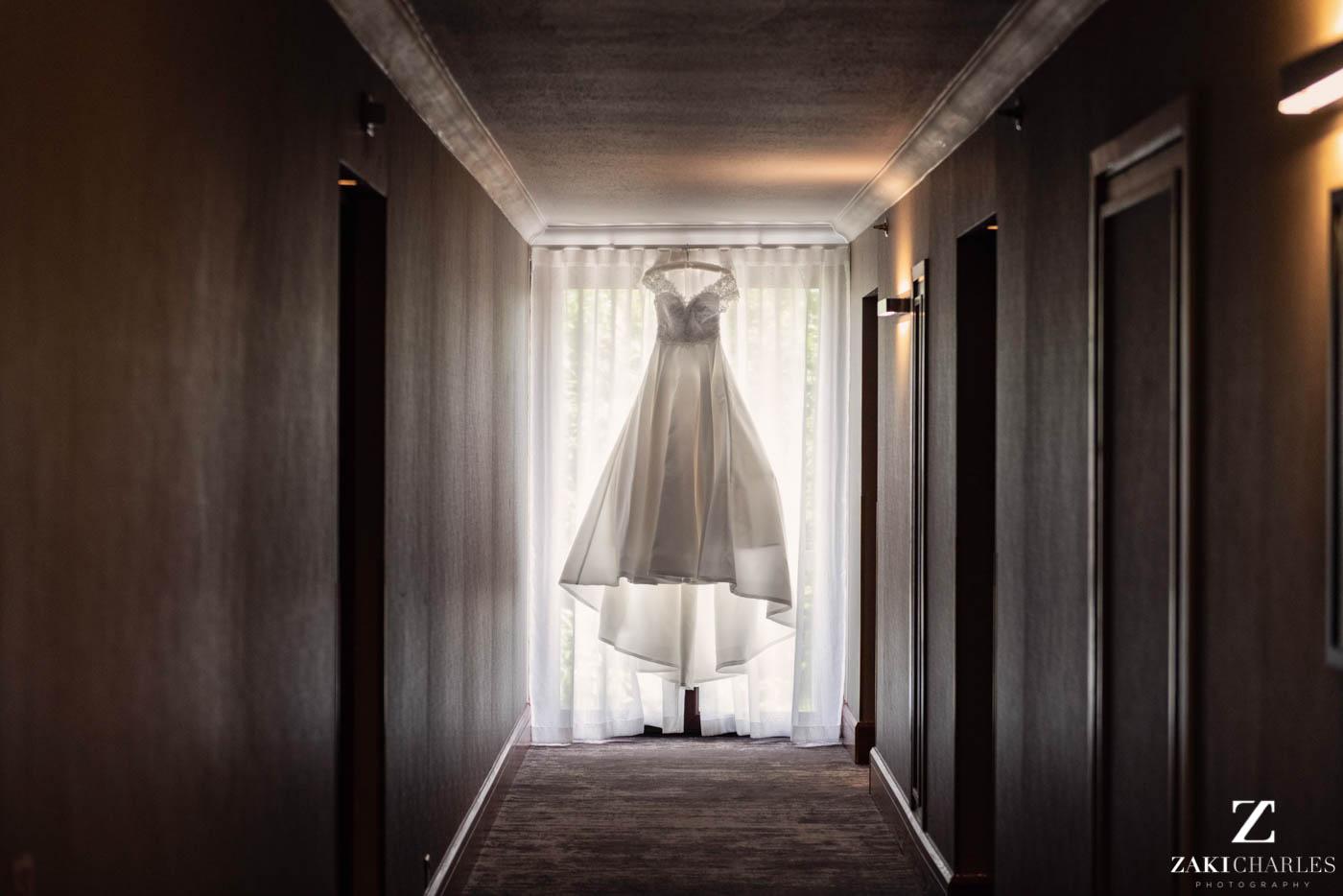 Dress of the bride hanging in Marriott Hotel Regents Park