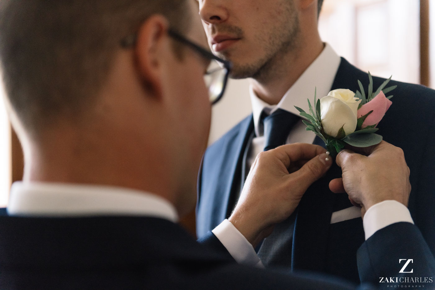 Buttonhole flowers on the groom in Eynsham Hall 2