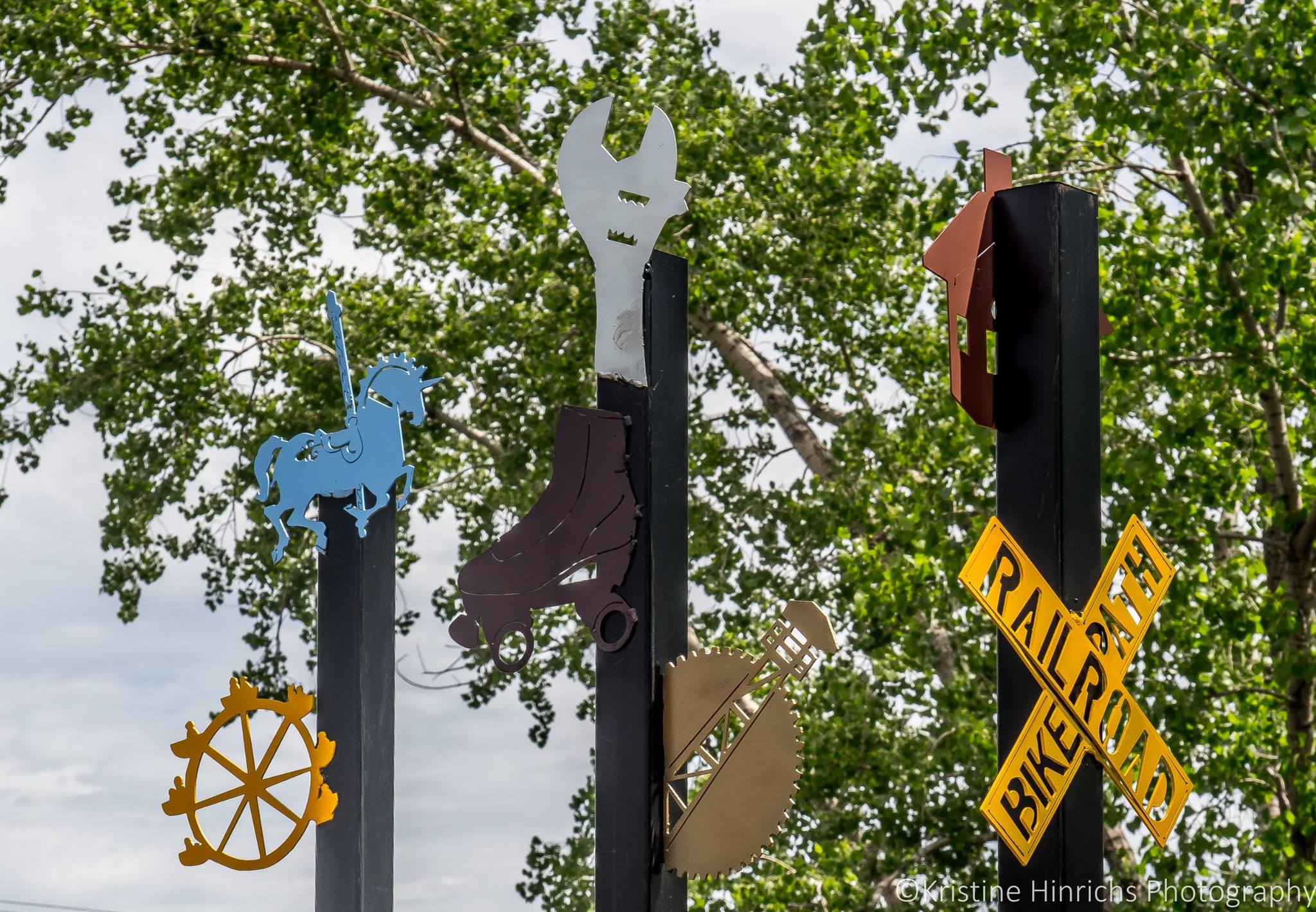 Provide enhancements   Sculptures, murals, benches, signs, and other art enhance the Trail and connect users to the area's culture and history.  Photo: Kristine Hinrichs Photography