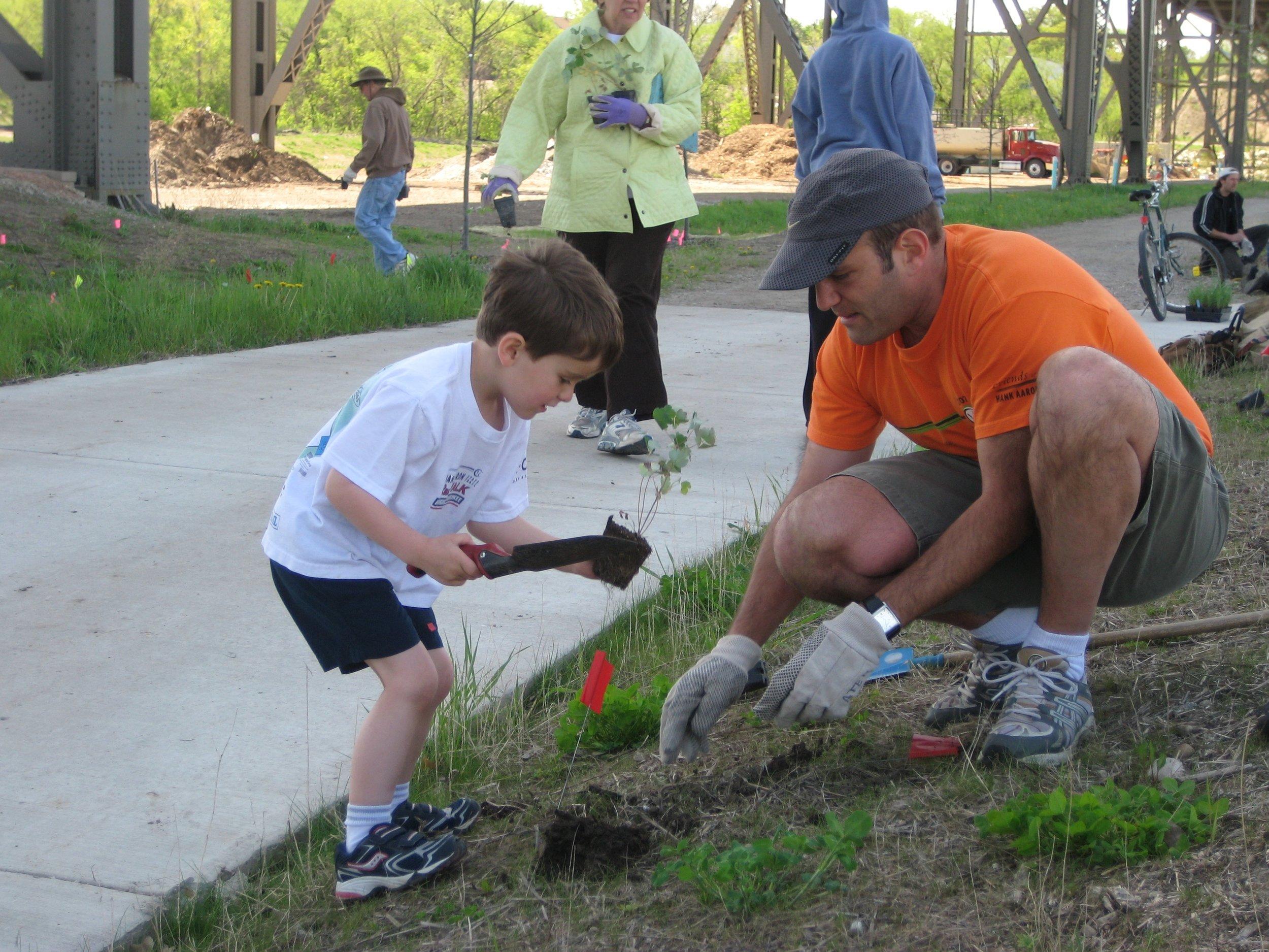 Bruce and Isaac Keyes planting.JPG