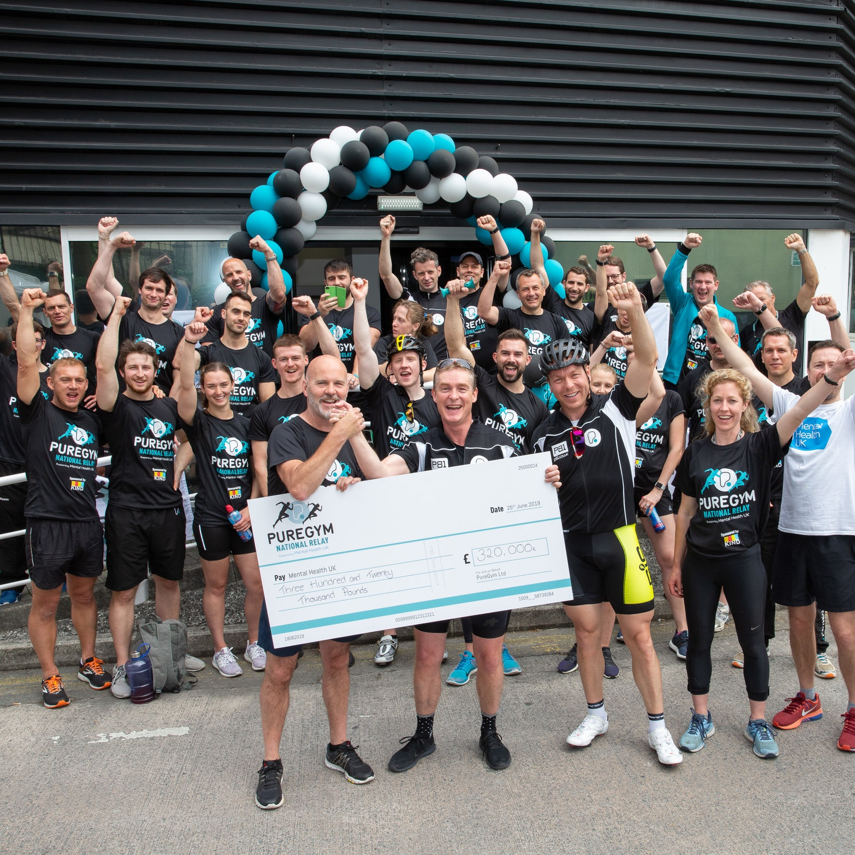 PureGym National Relay cheque giving