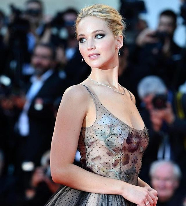 Jennifer Lawrence stuns in a sheer polka dot floor length gown from the Dior Spring 2017 collection at the Venice Film Festival while promoting her new horror flick. Love her makeup too! #bestdressed #mothermovie