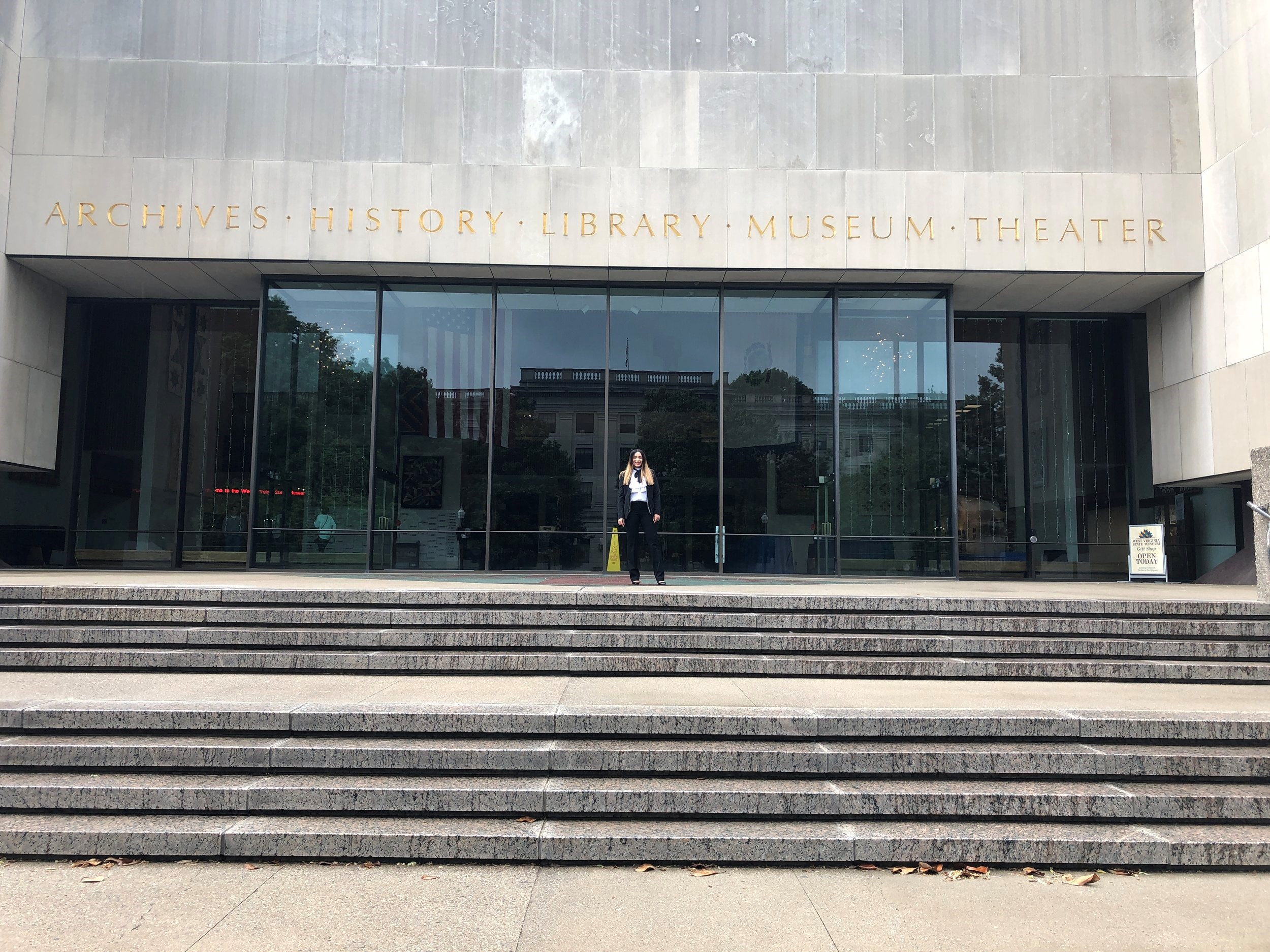 Dr. Mo on the steps of the West Virginia State's Archives * History * Library * Museum * Library at the Capitol, Charleston, West Virginia. May 11, 2019.