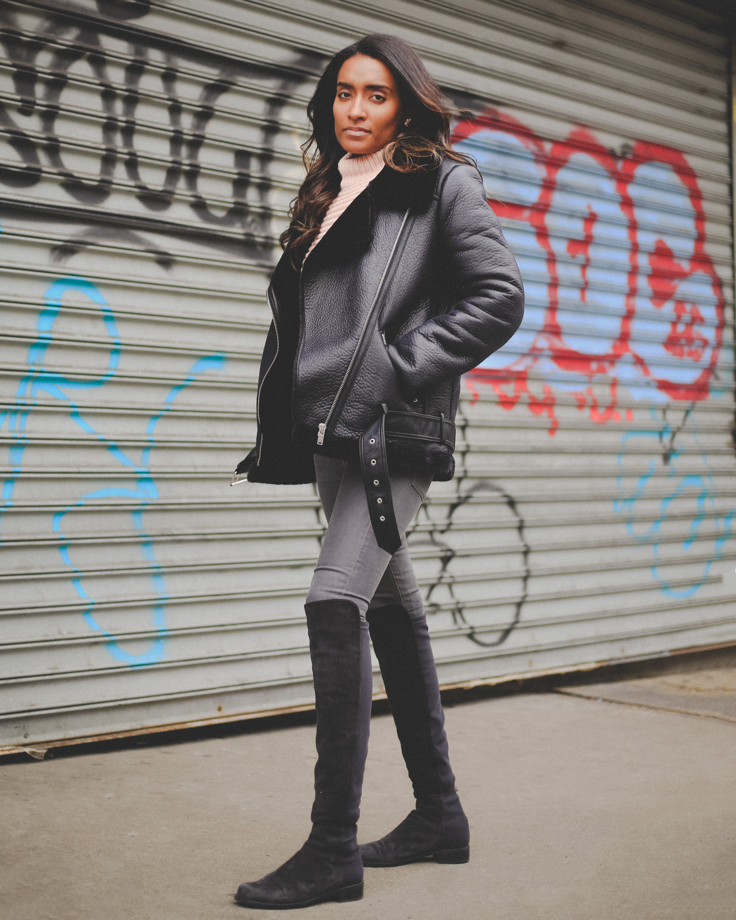 Krys is posing  with a Zara Motorcycle jacket.