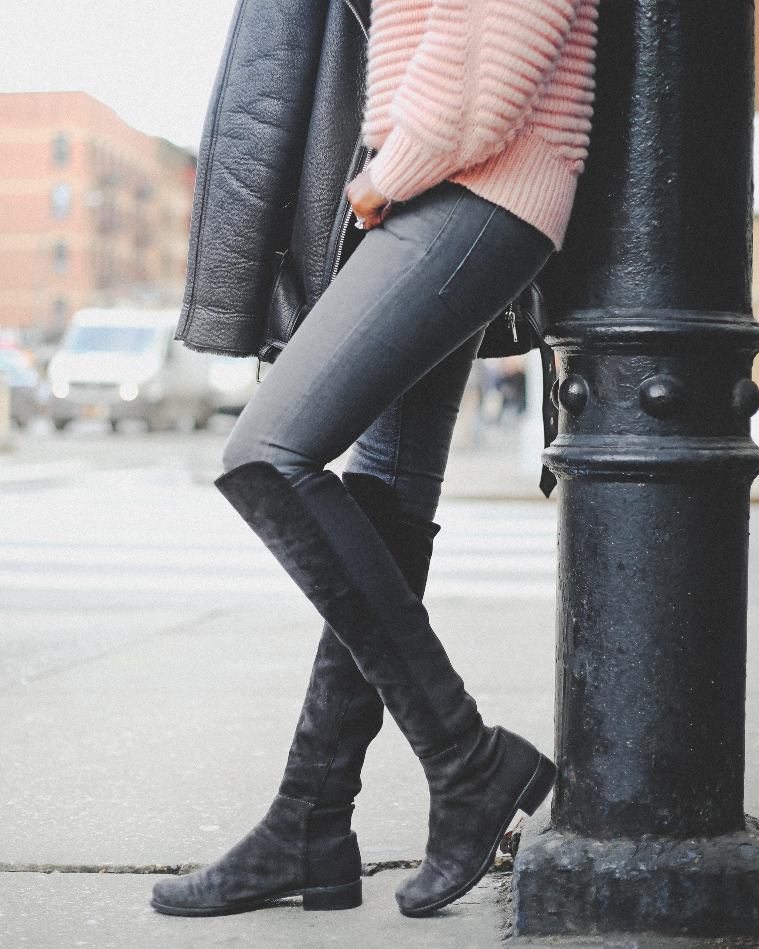 Krys modeling fall attire leaning against a street pole.