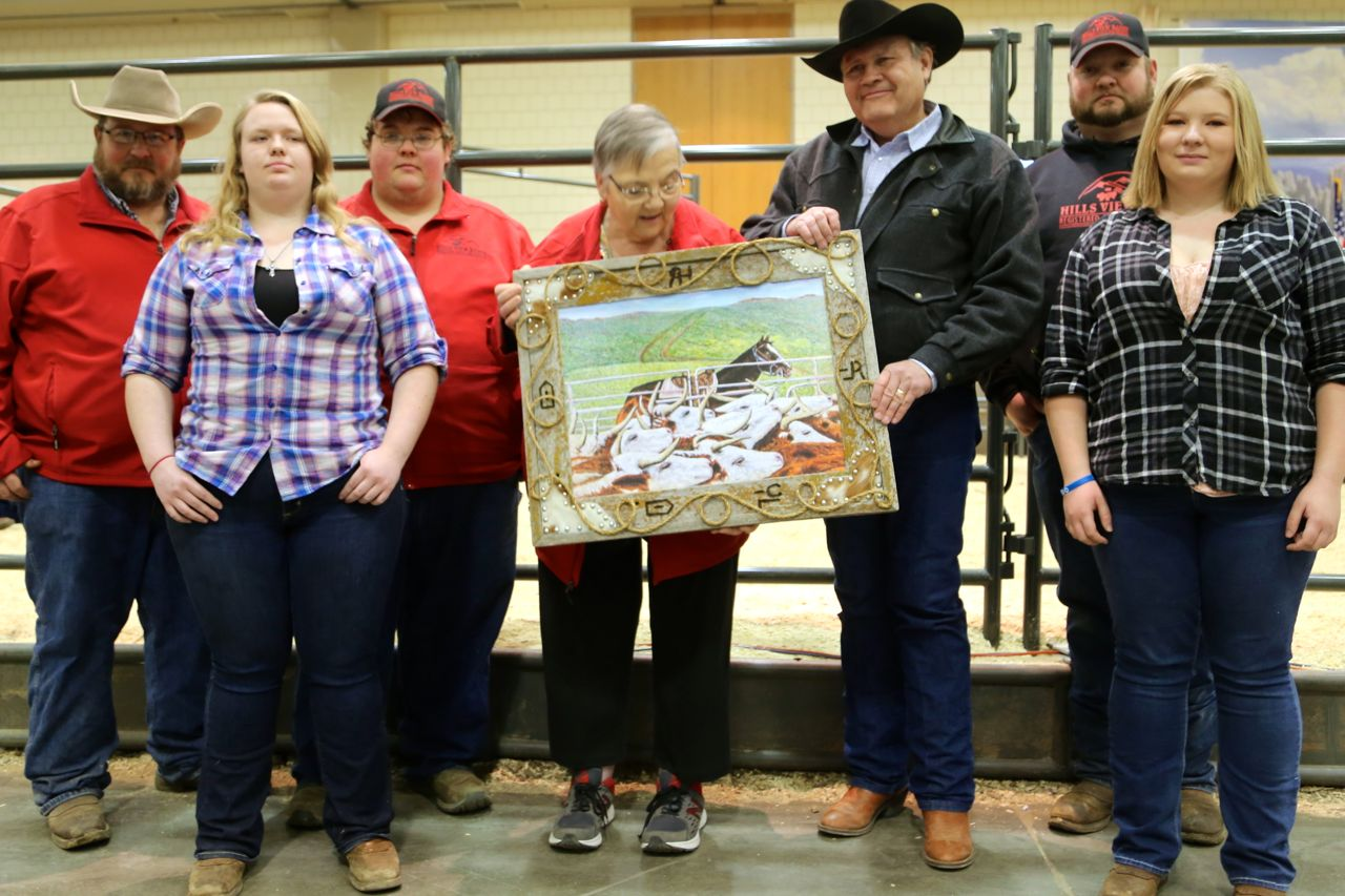 Family - For several years now, during the stockshow, the Reinhold family has presented a painting to a family that has enjoyed the tradition of the Black Hills Stock Show & Rodeo, particularly Hereford Day. We do this in honor of Tige Reinhold. This year we honored the Woods family of the Hillsview Ranch. It was a pleasure to present this painting by Bob York to our neighbors.