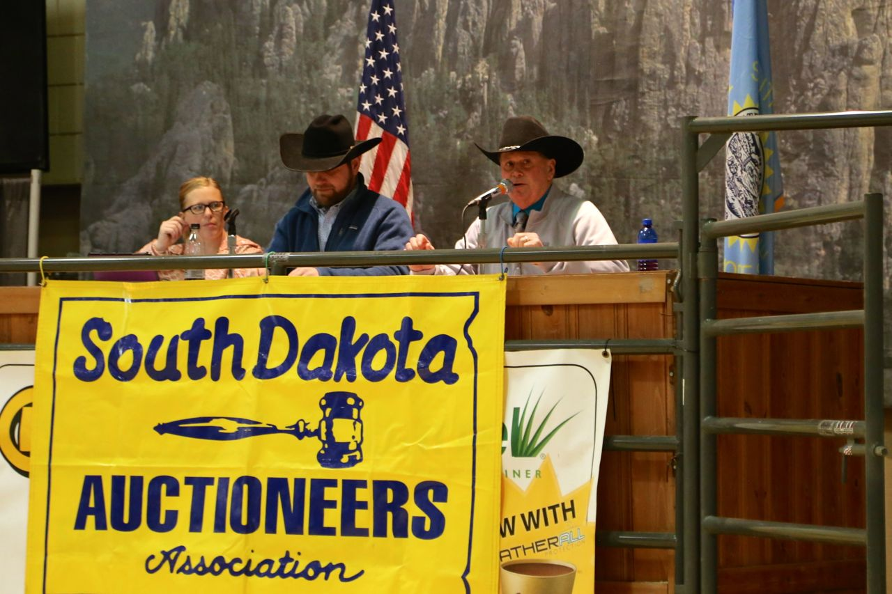 Auctioneering Contest - Our good friend, Ken Wintersteen, of Olivet, South Dakota demonstrating his skills. Around thirty auctioneers took part, but the young man below taking bids nearly stole the show.