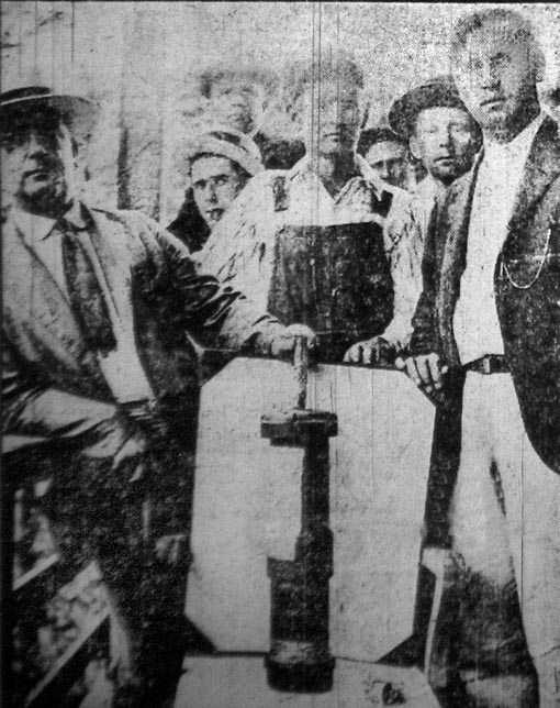 Miners show off a bomb dropped on them during the siege.