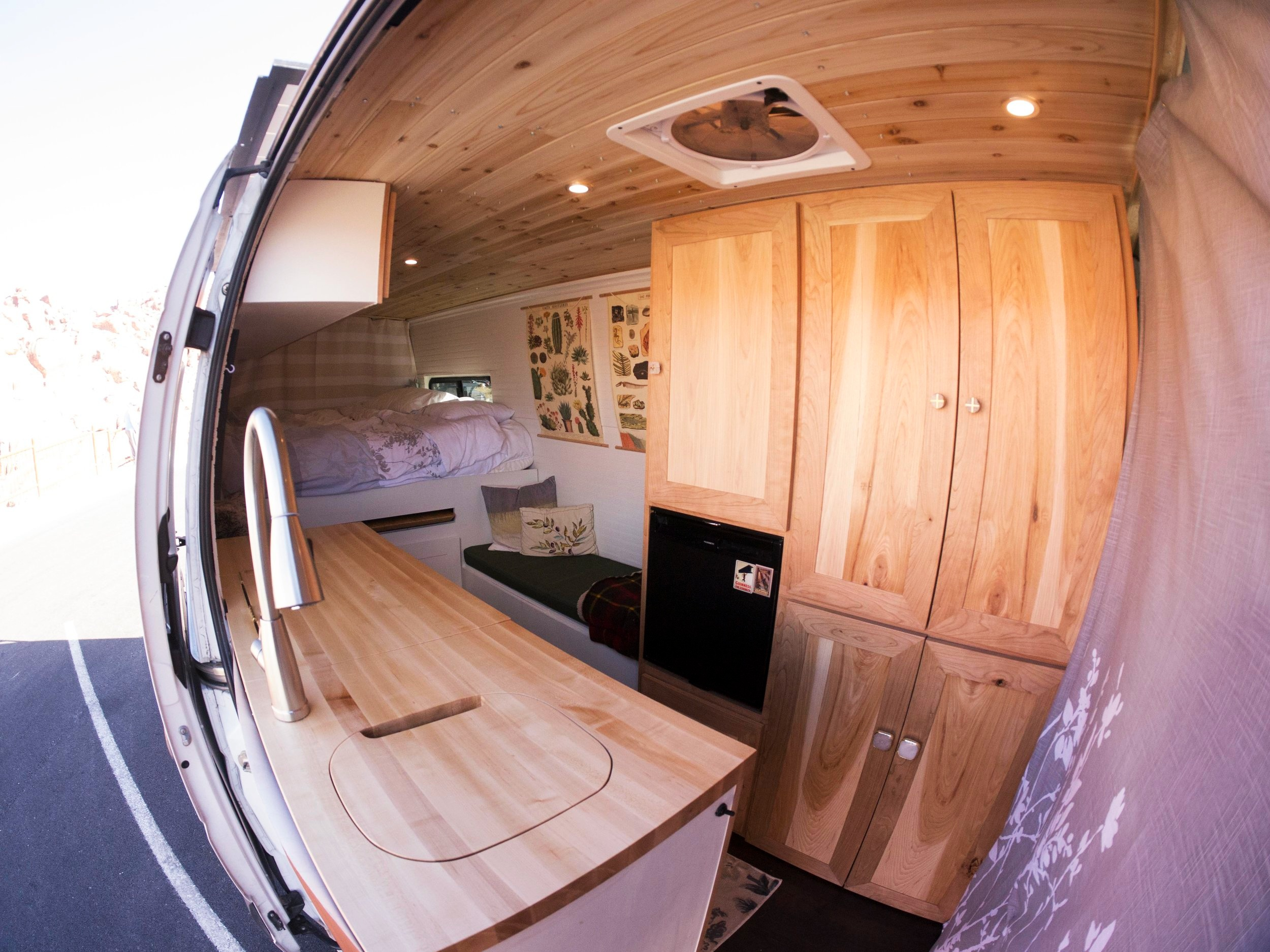 A brief overview of the van, it's a 2013 Mercedes Sprinter that I converted for a woodworking class while still in art school. I did all the work myself within the span of about 2 months. Cabinets are Hickory and Cherry, Maple butcher block countertop, 530watts of solar which powers a fridge, lights fans, water system and power outlets, insulated the whole van with sheeps wool and has tons of storage! A lot of design thinking used to figure out the layout best suited for my girlfriend and I, along with a ton of experience gained through building. If you have any questions I'm more than happy to help!