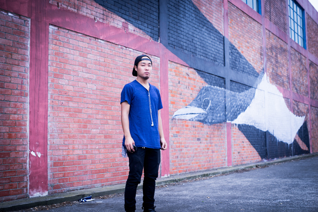 TWOONE in front of his partially painted wall in Napier, 2016. Photo: Sonia Sly