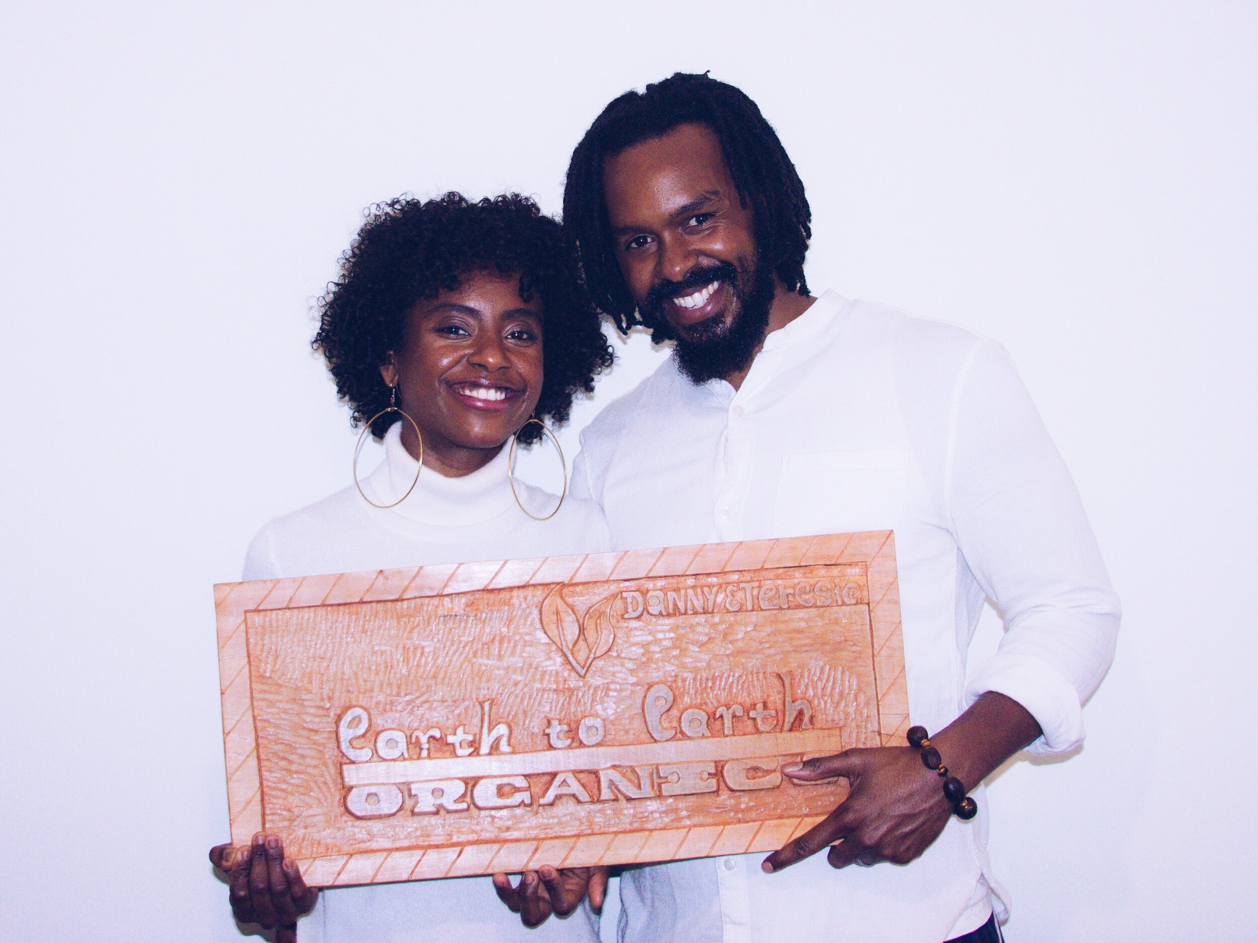 Us with plaque.JPG