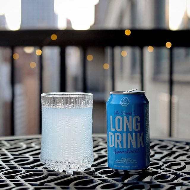 "In Finland, the ""long drink"" dates back to the 1952 Summer Games in #Helsinki, when the host city created a cocktail from gin and grapefruit soda for its guests. Today, you can find the beverage on draught in bars and restaurants around Finland -- and now, in cans shipped to the U.S. by a brand called @TheLongDrink Company. With its bright effervescence and tart citrus flavor, the bevvy tastes a lot like a gin-and-tonic mixed with Fresca -- but as someone who can't stand sugary sodas, I'm thankful that it's not especially sweet. And at 5.5% ABV, you can knock down a few of 'em without regretting it the next day. For the full experience, I'm enjoying it out of classic Finnish glassware -- @iittala's #UltimaThule tumbler by legendary Finnish designer #TapioWirkkala -- and listening to a uniquely Finnish soundtrack provided by @EnsiferumMetal's self-titled 2001 debut. To be honest, I'd only learned of this band when @Krovatinist recently mentioned seeing them on the @70000Tons of Metal cruise back in February, and he and @CatJooones celebrated with a viking-like march around the @KerrangMagazine_ office to this very record. The Helsinki-based folk metal outfit plays galloping music fit for a triumphant cruise down the Kokemäenjoki River -- and this first album showcases them at their purest and best. It doesn't get more Finnish than this. . #TheLongDrink #LongDrink #Cocktail #Cocktails #Finland #Finnish #Kippis #FinnishStrong #HelsinkiPride #Finland🇫🇮 #livelongdrink #EnsiferumMetal #Ensiferum #FolkMetal #FinnishMetal #FinnishMetalhead #PaganMetal #VikingMetal #HelsinkiOfficial"