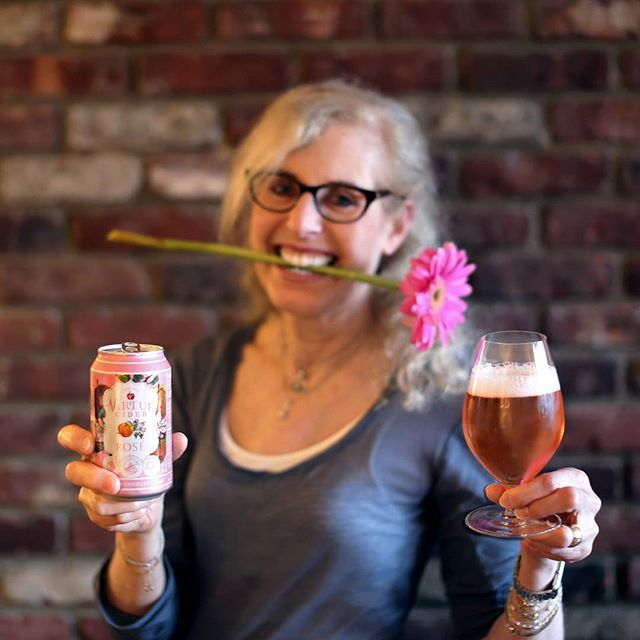 "My mom (@muttnutt) is no drinker. In fact, I can count on one hand the number of times she's had more than one sip of an alcoholic beverage. But she loved @VirtueCider's rosé so much that she asked to endorse it as a spokesmodel on my feed. In fact, she directed every detail of this bizarre shoot, down to the flower in the mouth (I have no idea). I'm just stoked that she's into this deliciously dry, wine-like cider, which is aged in French oak barrels. Made with hand-pressed heirloom Michigan apples and a botanical blend of citrus oil, sage, and hibiscus, the floral, fruity aromas and crisp, tart finish of this gorgeous pink refresher would go perfectly with oysters, Camembert cheese, or watermelon on a summer picnic. Of course, for a musical pairing, I let my mom make the call. Knowing how this works, she went with @RomanticsDetroit's self-titled debut -- not only for its provenance (Michigan) and aesthetic (pink-themed cover), but of course, for its classic single. The 1980 record is best known for ""What I Like About You,"" a moderate success upon release, but a smash hit nearly a decade later when licensed by Budweiser for commercial use. (Especially funny when ""Cherry, Cherry"" by Neil Diamond -- which shares almost the EXACT same riff -- came out in 1966...) What my mom likes about this beverage and album is their accessibility; what I like about my mom is her sense of humor. (Follow this weird-ass chick! @muttnutt) . #VirtueCider #VirtueCiderRosé #Rosé #RoséAllDay #Cider #CiderTime #CiderTasting #FarmhouseCider #MichiganCider #Michigan #Detroit #DetroitMI #TheRomantics #Romantics #WhatILikeAboutYou #Mom #Mother #FunnyMom #MomHumor #MomTime"