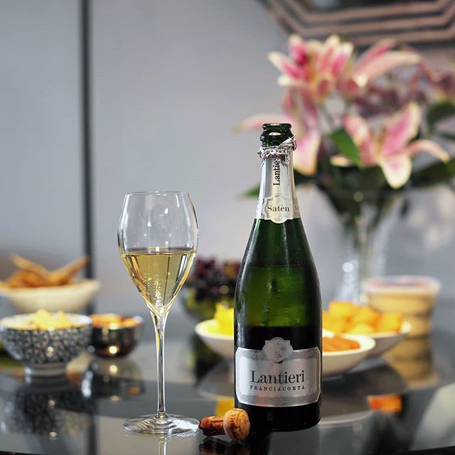 """Quite simply, #Franciacorta doesn't get enough credit. Produced in the traditional method just like Champagne (i.e. with a secondary fermentation in the bottle), the wine provides all of the flavor, elegance, and complexity that Champagne does -- it just happens to come from the province of Brescia in Lombardy, Italy, rather than a more famous region in France. This particular bottle is a new favorite of mine, from @Lantieri_Franciacorta, a family with winemaking roots dating back to the 10th century. Like all Franciacorta labeled as """"Satèn"""" (which means """"silk"""" in Italian), this wine is made from 100% Chardonnay and has less bottle pressure than other sparklers, thanks to the lower level of sugar in the liqueur de tirage for the yeast to chow down on during secondary fermentation. The result is a soft, creamy, and...well...silky sparkling wine, with ripe peach and white flowers on the nose, and hazelnut, vanilla, and brioche on the palate. Paired with this smooth beverage is the latest release from an equally graceful and underrated band: @TheAppleseedCast. Their new record, The Fleeting Light of Impermanence, is an elegant, passionately made distillation of all their post-rock, indie, and emo influences -- and easily their best work in 15 years. I hope it'll get them the attention they deserve as a veteran act -- much like the Lantieri family and the Franciacorta wine they produce. Read all about the new Appleseed album -- and their entire discography! -- in my new interview with frontman Chris Crisci for @KerrangMagazine_. Link in bio! . #Lantieri #LantieriGlam #FranciacortaWine #FranciacortaWines #FranciacortaLovers #SparklingWine #SparklingWines #Wine #Wines #WineTasting #WinePairing #ItalianWine #Italy #Lombardy #BresciaItaly #TheAppleseedCast #AppleseedCast #GravefaceRecords #Emo #EmoRock"""