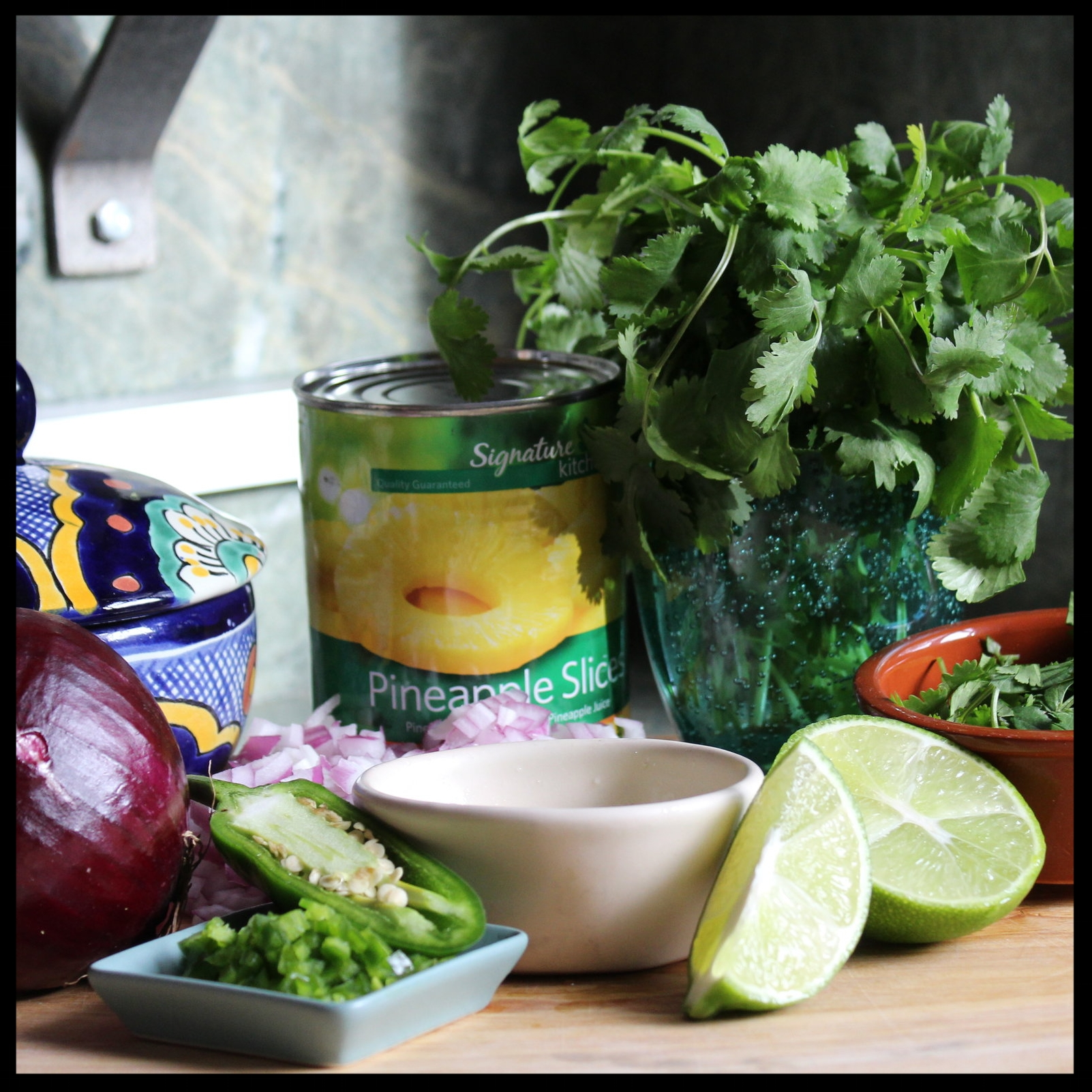 "WHAT YOU NEED:   - 1 can of pineapple in its own juice   - 1/2 jalapeno (about 3"" long), seeded and finely chopped (reserve the other half for later)  - 1 small red onion, diced finely  - 1 cup (or more if you like) chopped cilantro  - juice of 2 limes   - 1 tsp EACH ground cumin, dry oregano and chili powder  - 1/2 tsp EACH salt and ground black pepper"