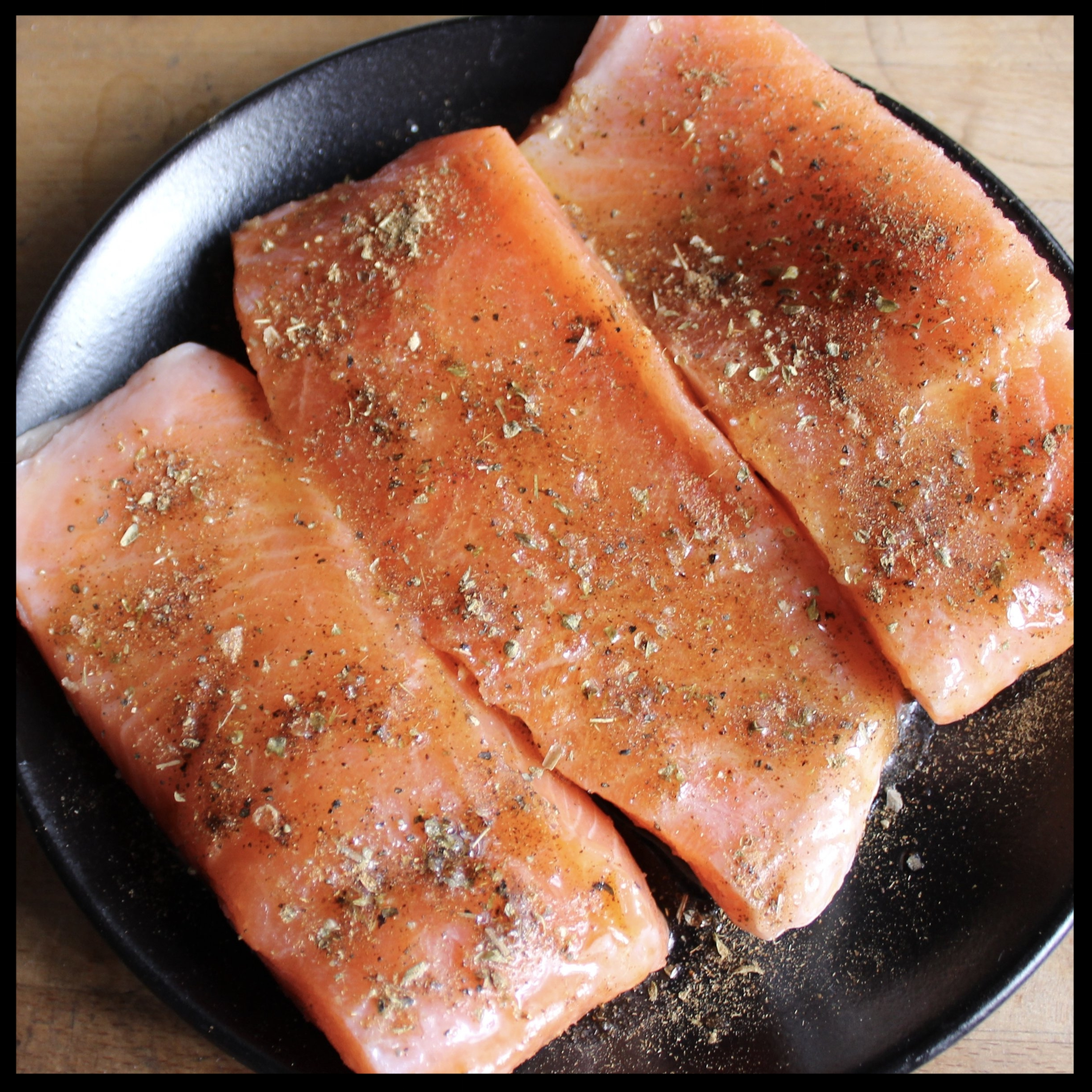 INSTRUCTIONS:   1. Preheat your oven to 400 degrees  2. If your salmon has been frozen and defrosted (like mine was) pat both sides dry with a paper towel.  3. Lay on a plate, skin side down, and season liberally with your LATIN SPICE RUB and drizzle with olive oil  4. Return salmon to the fridge without covering.