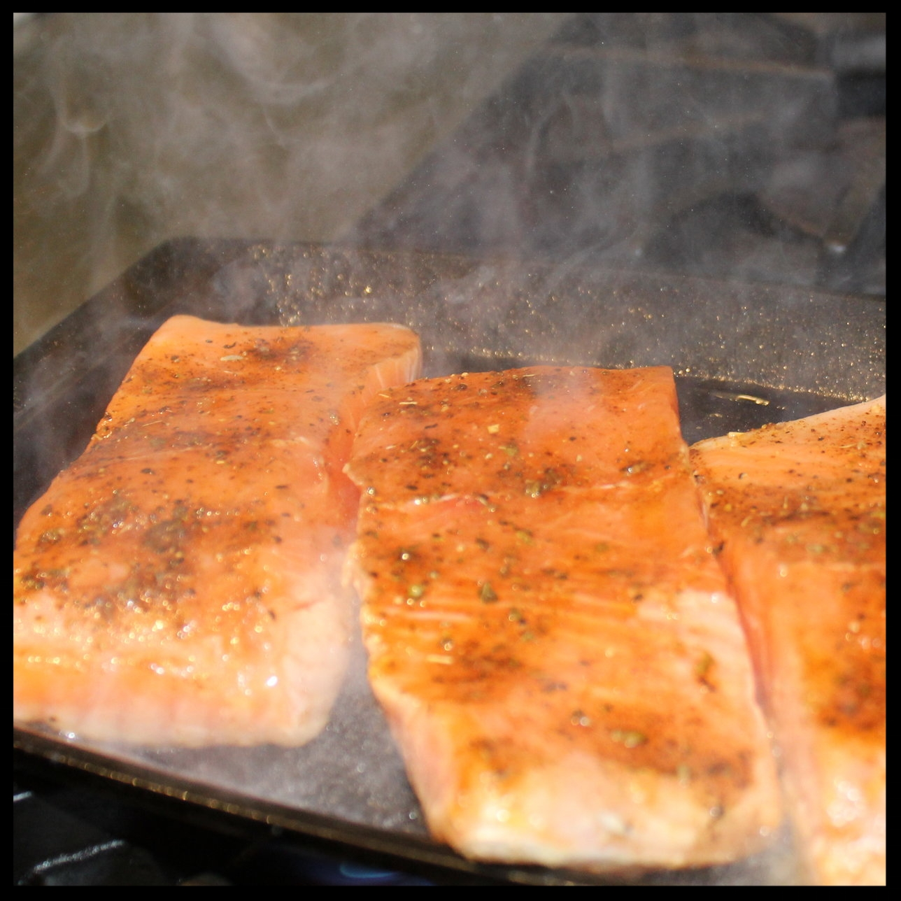 25. Turn your oven up to broil.  26. In to a VERY HOT heavy pan (I use cast iron), put your salmon skin side down and sear for about 3 minutes.