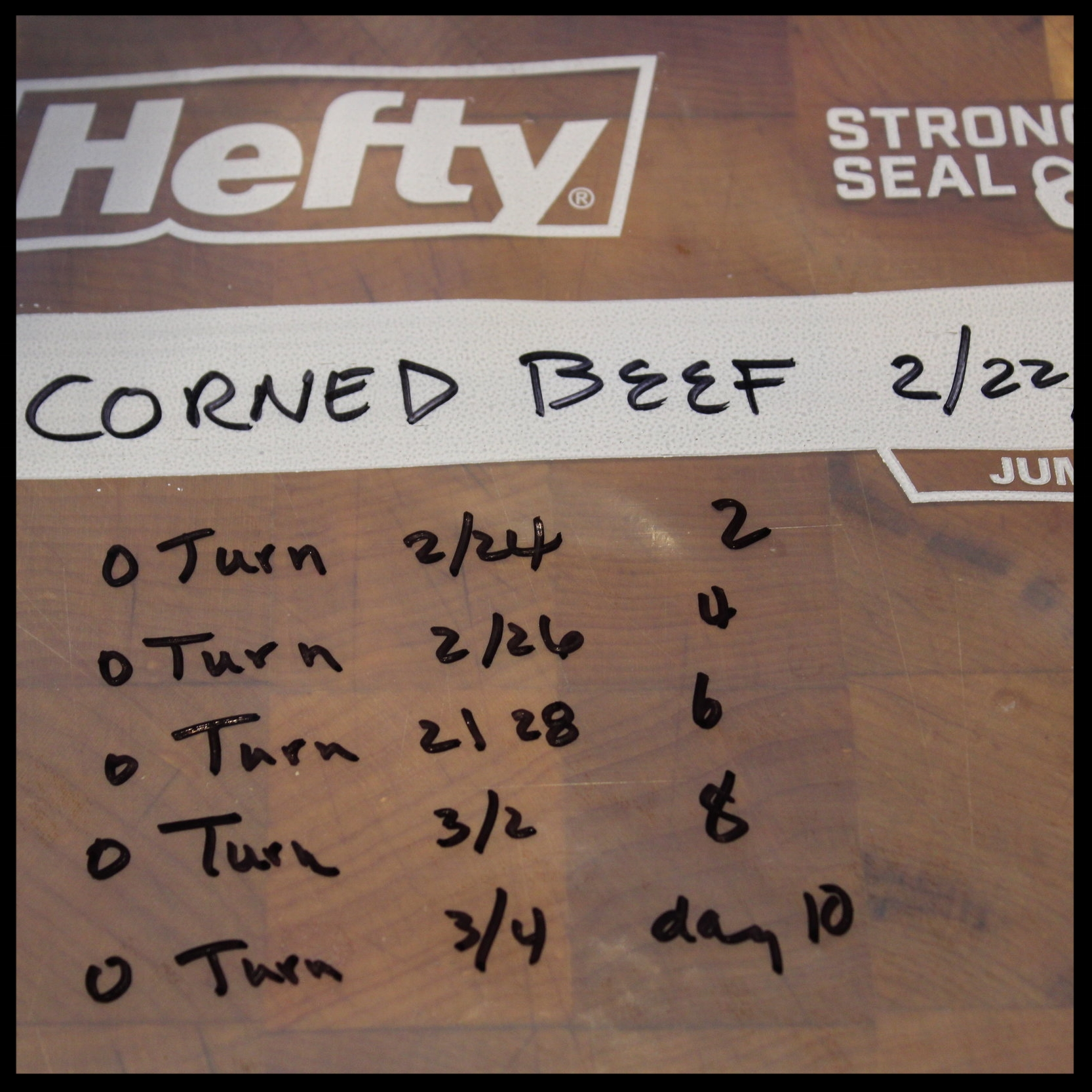 8. While you are waiting for the brine to cool, set up your corning bag. Write that date you started with a marker, and write out your schedule of turning the bag, checking each date off as you do. If you miss a day, don't worry; we just want to make sure both sides of the beef get equal exposure to the brine.