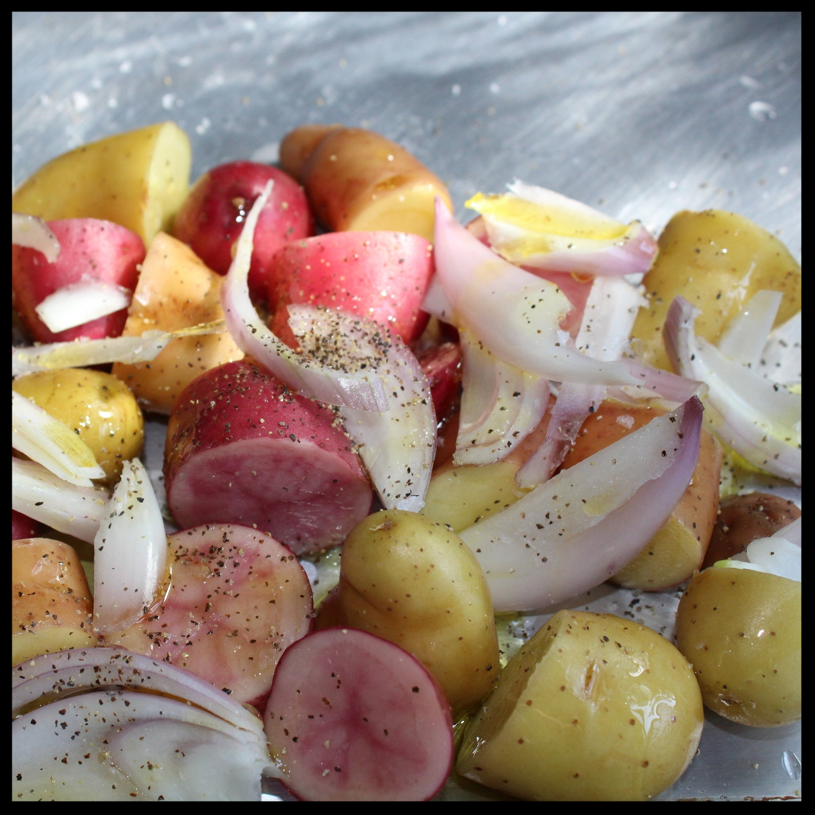 INGREDIENTS:   - 1/2 pound small potatoes/person - washed and cut into equal portions (I used a mix of pink, yellow, peewee)  - 1 large shallot, peeled and cut lengthwise into long strips  - 3-4 rainbow carrots/person - scrubbed, peeled, and cut lengthwise into equal sizes  - extra virgin olive oil  - salt and pepper to taste