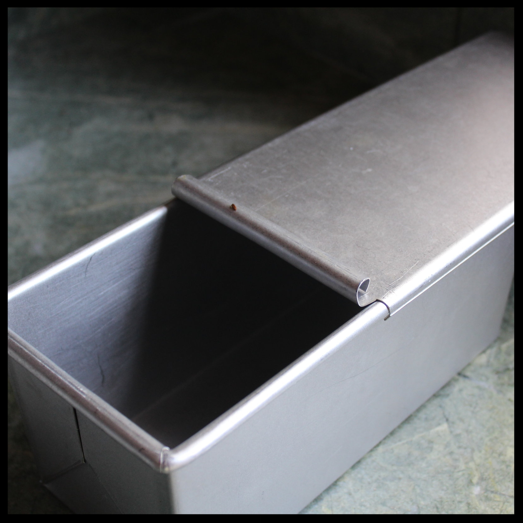 KIDDOCJJ tip: for those of you who are unfamiliar with a a Pullman Pan, here's one. These are wonderful when you are trying to make a perfectly square loaf of bread, like with brioche, or any sandwich loaf. They can be used with their tops (that slide on and off), or topless!    If using loaf pans without tops, you'll have a pretty loaf as well, but with the characteristic curvy top.