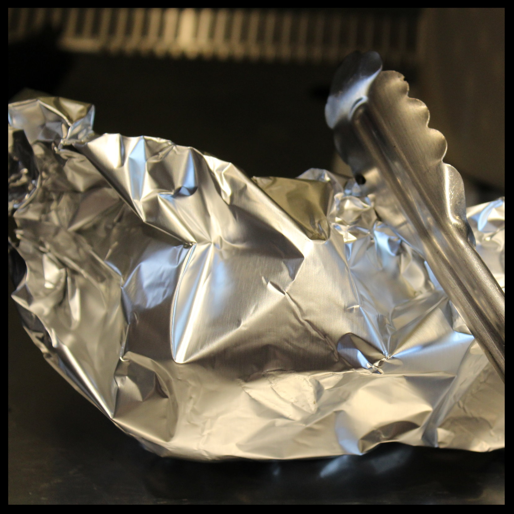 Now wrap them up in some foil, or put into a paper bag (be careful that the pepper has no active flames going) for about 15 minutes. This step essentially steams the pepper, which hugely helps when you are trying to remove the skin.  Now walk away for a few.