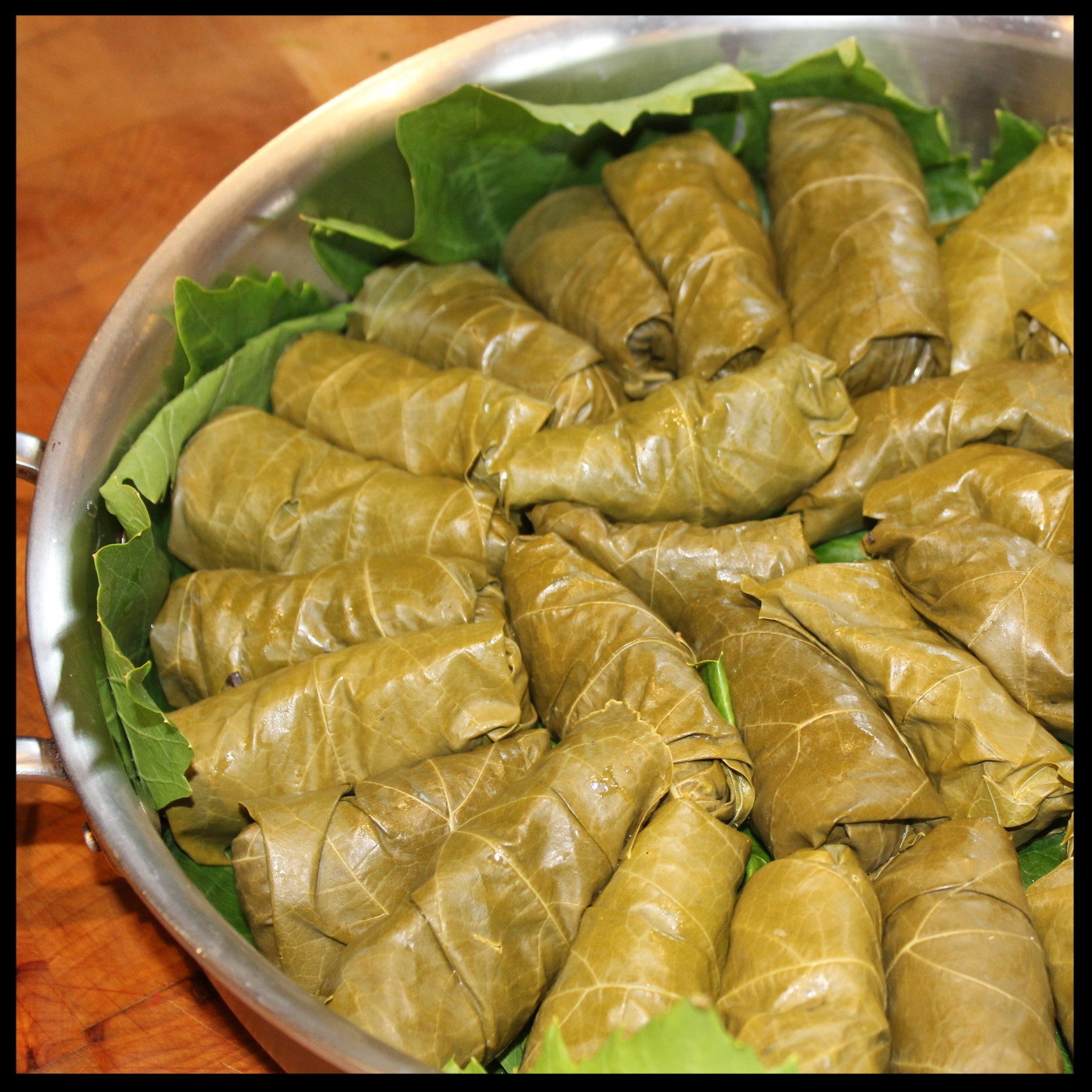 15.  The key to retaining the shape of the dolmas is to pack them fairly tightly in your pan.