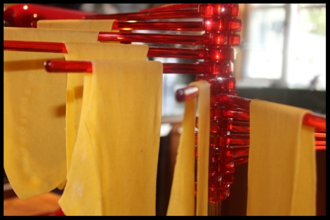 Egg pasta sheets drying on my  favorite rack  by Marcato Atlas.