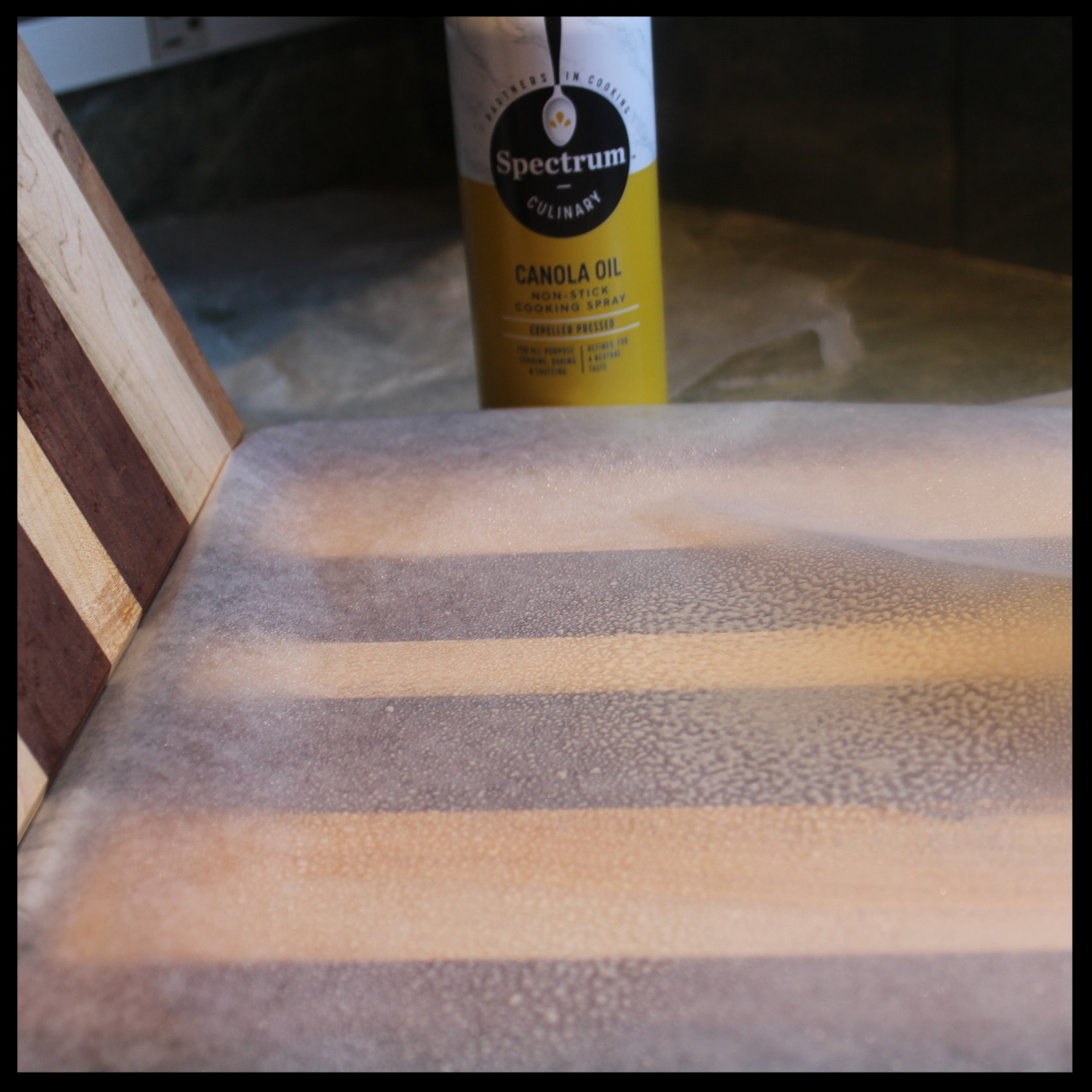 6. Whatever kind of press you use needs to be lined. Don't use plastic wrap or parchment - they will stick to the dough. The best thing to line your press with is waxed paper, sprayed lightly with vegetable spray. (This keeps your press clean, too!)