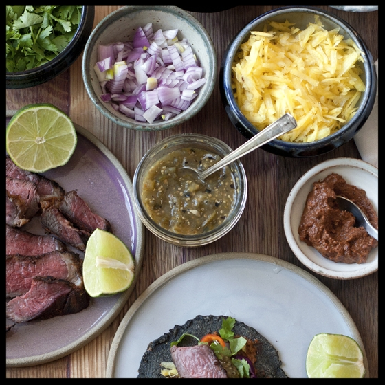 14.  I love to set up a taco station with a protein (steak or fish are my favorites, some pinto or black beans, chopped red onion, salsa, cilantro, limes and some salty Mexican cheese like Cotija or some shredded  pepper Jack.  It's also fun to have some pickled jalapeno peppers or pickled carrots and onions for an extra kick.