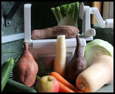 """The  Paderno Spiralizer  (generation 2).....suction feet hold it steady on the counter, there's a blade """"garage"""" beneath, all parts are easily assembled and disassembled, easy to clean, and folds up like a Ninja! I tried a pretty good assortment of vegetables to see what really works, so let's get to it!"""