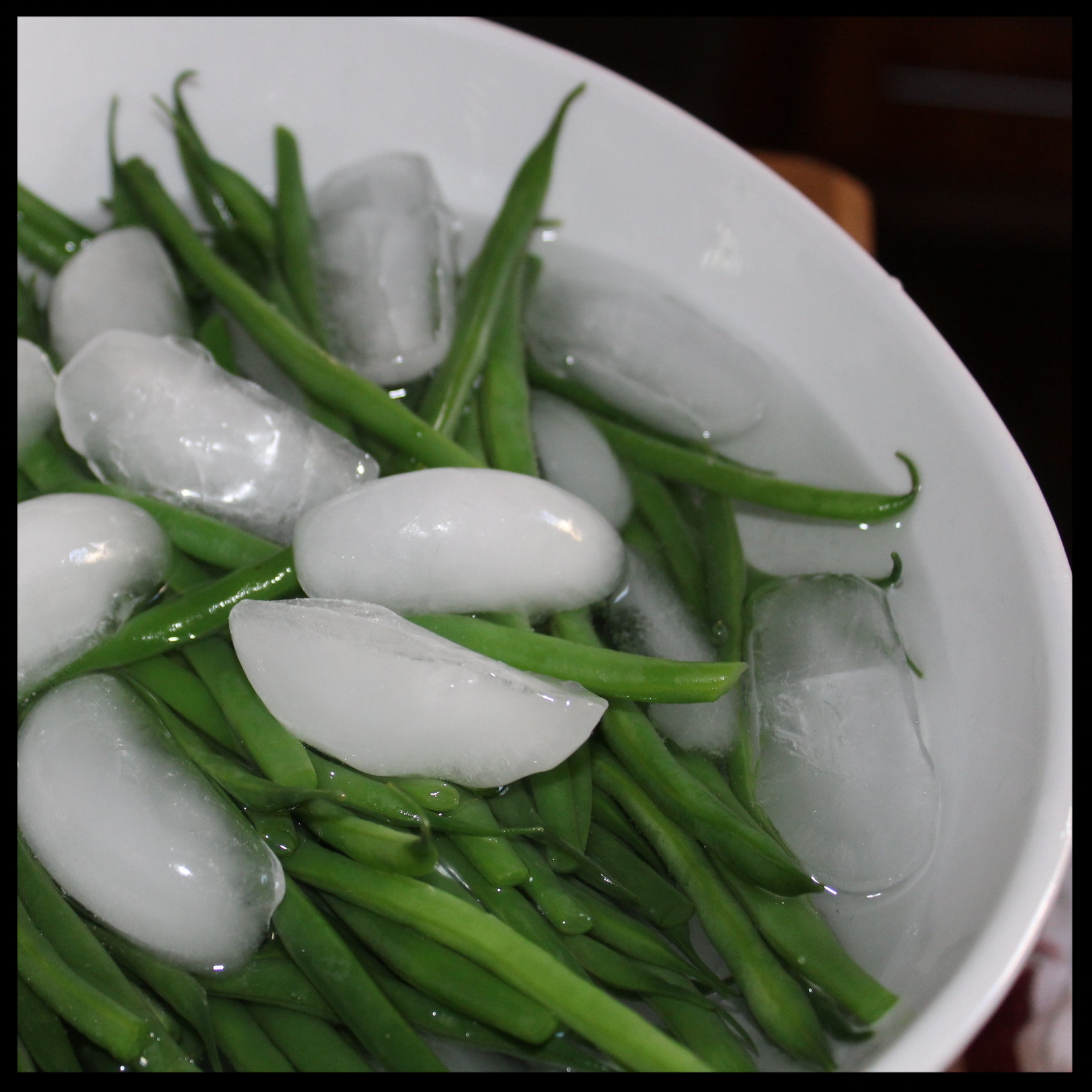 3. With tongs remove the veggies and place in a bowl filled with ice and water. Let cool. Remove to a strainer and refrigerate until ready to use.