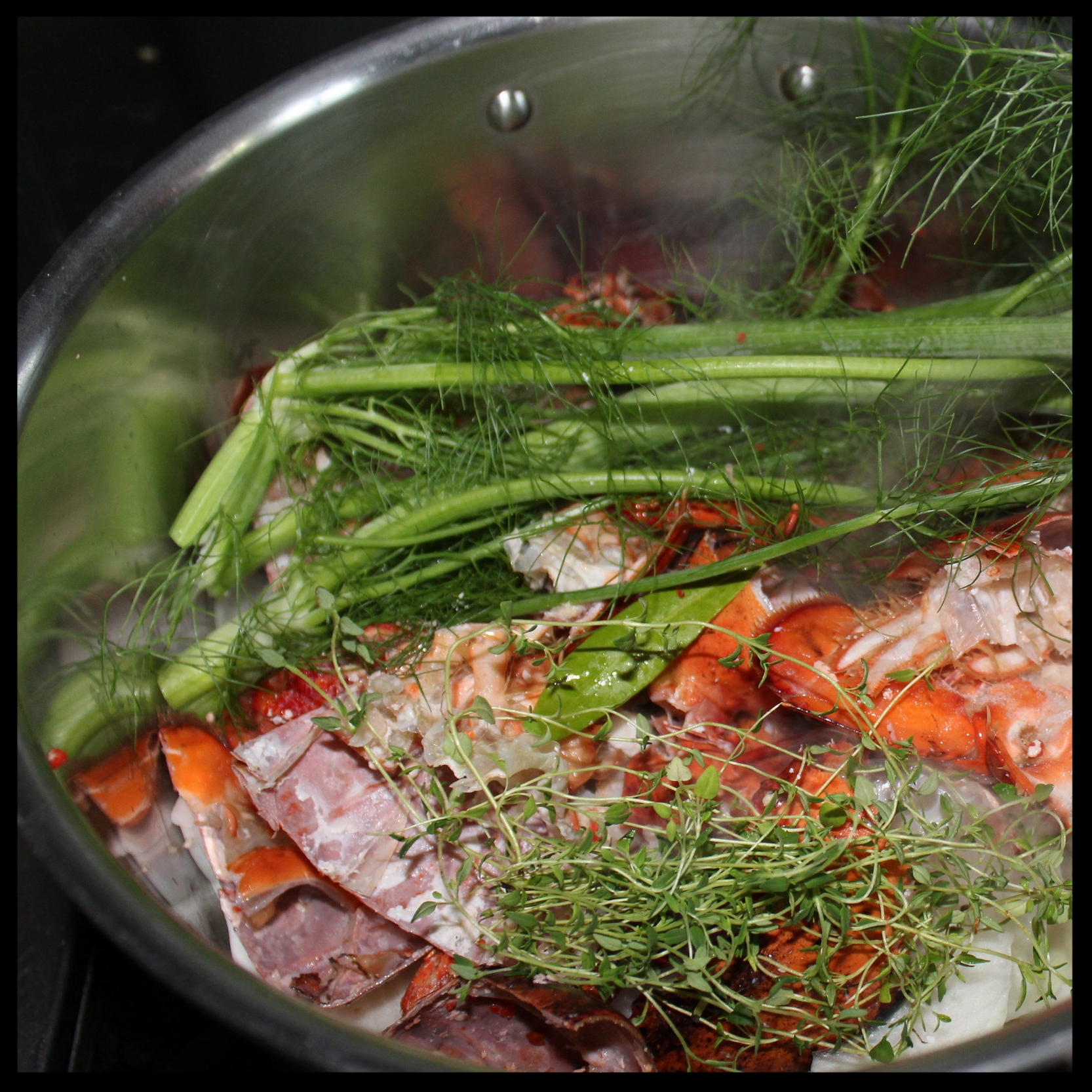 INSTRUCTIONS:   1.  Cut lobster shells into 2-3 inch pieces with kitchen shears  2.  Drizzle 2 TB olive oil into a large stockpot with heat on medium-high.  3.  Throw in the shells, onion, garlic, and pepper flakes and stir periodically until onions are limp and translucent, but not brown.  4.  Add the thyme and bay leaves as well as the fennel fronds, and stir to mix.