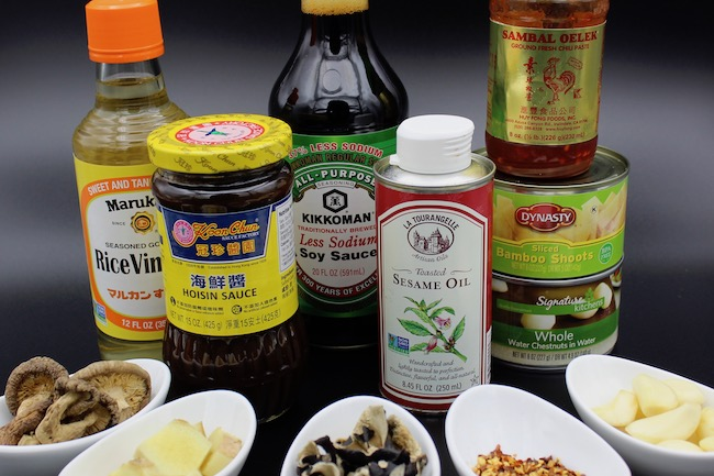 From left to right: Rice vinegar, Hoisin sauce, low sodium soy sauce, sesame oil, Sambal Oelek (ground chili paste), bamboo shoots, whole water chestnuts
